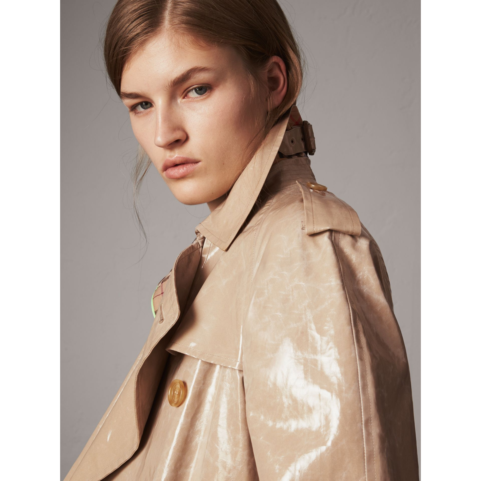Raglan-sleeve Laminated Gabardine Trench Coat in Honey - Women | Burberry United Kingdom - gallery image 1