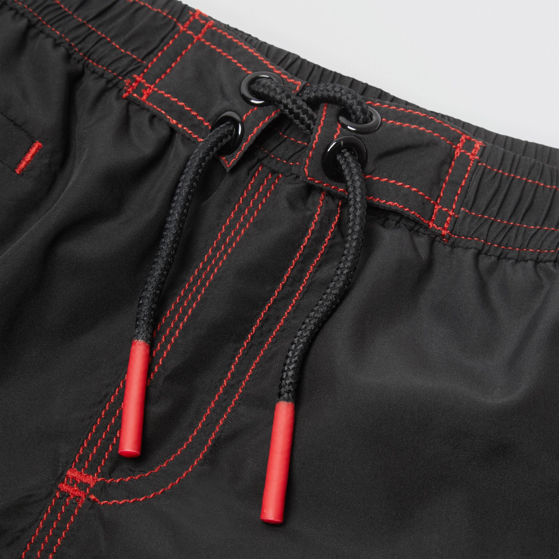 Logo Print Drawcord Swim Shorts in Black | Burberry - gallery image 1