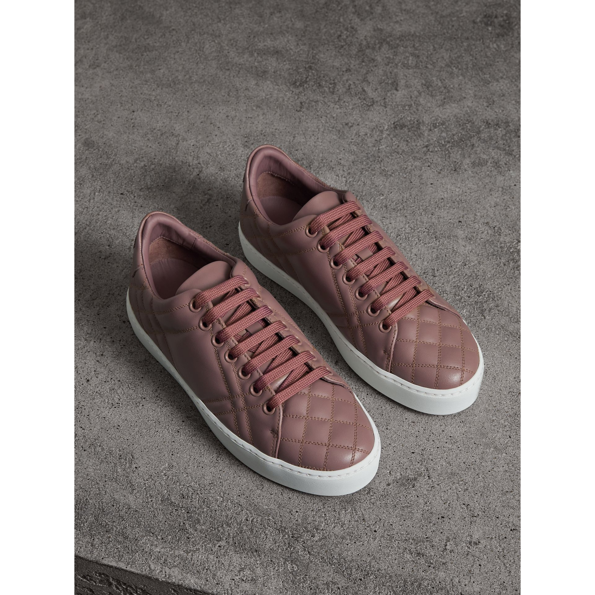Check-quilted Leather Trainers in Ivory Pink - Women | Burberry United Kingdom - gallery image 1