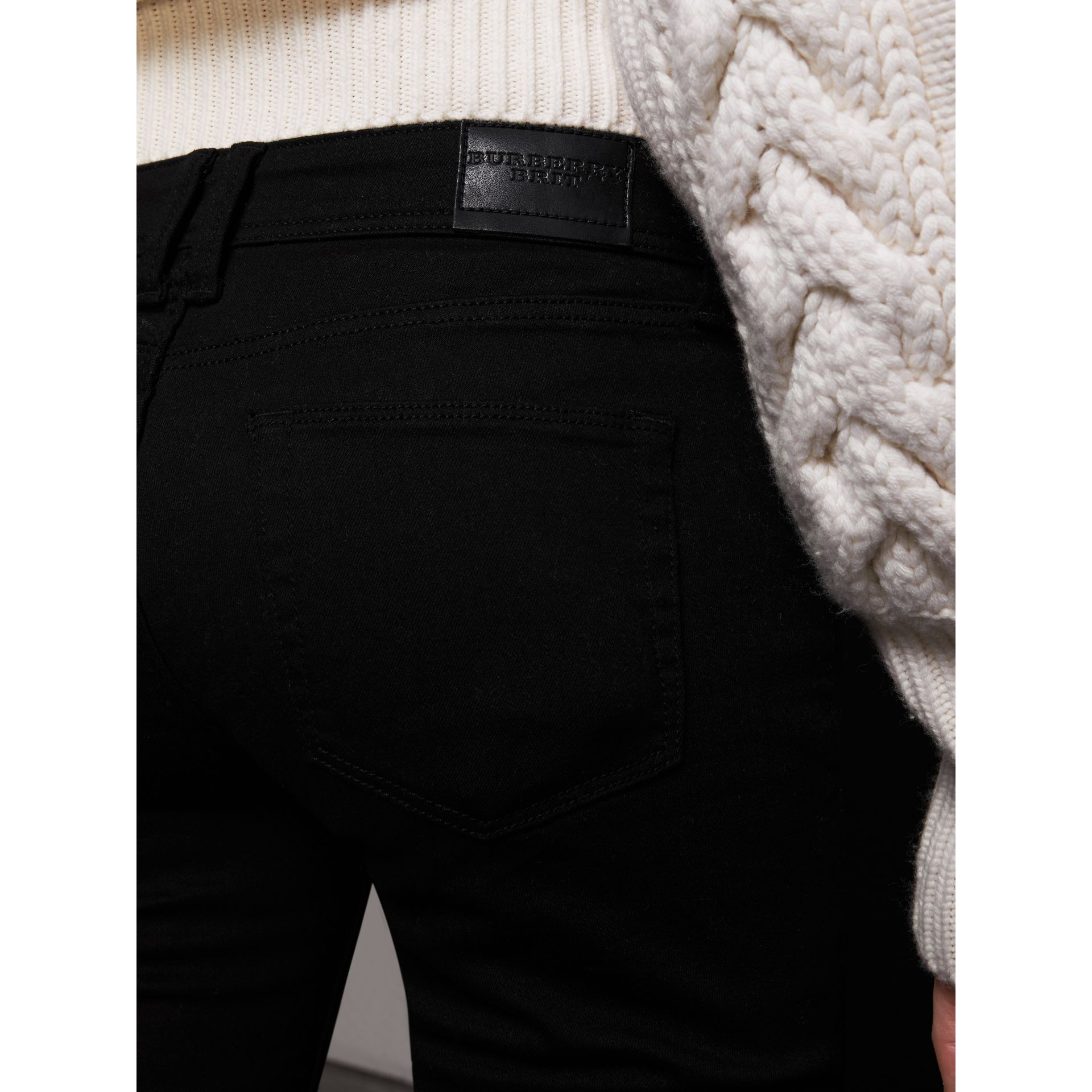 Skinny Fit Low-Rise Deep Black Jeans - Women | Burberry United Kingdom - gallery image 1