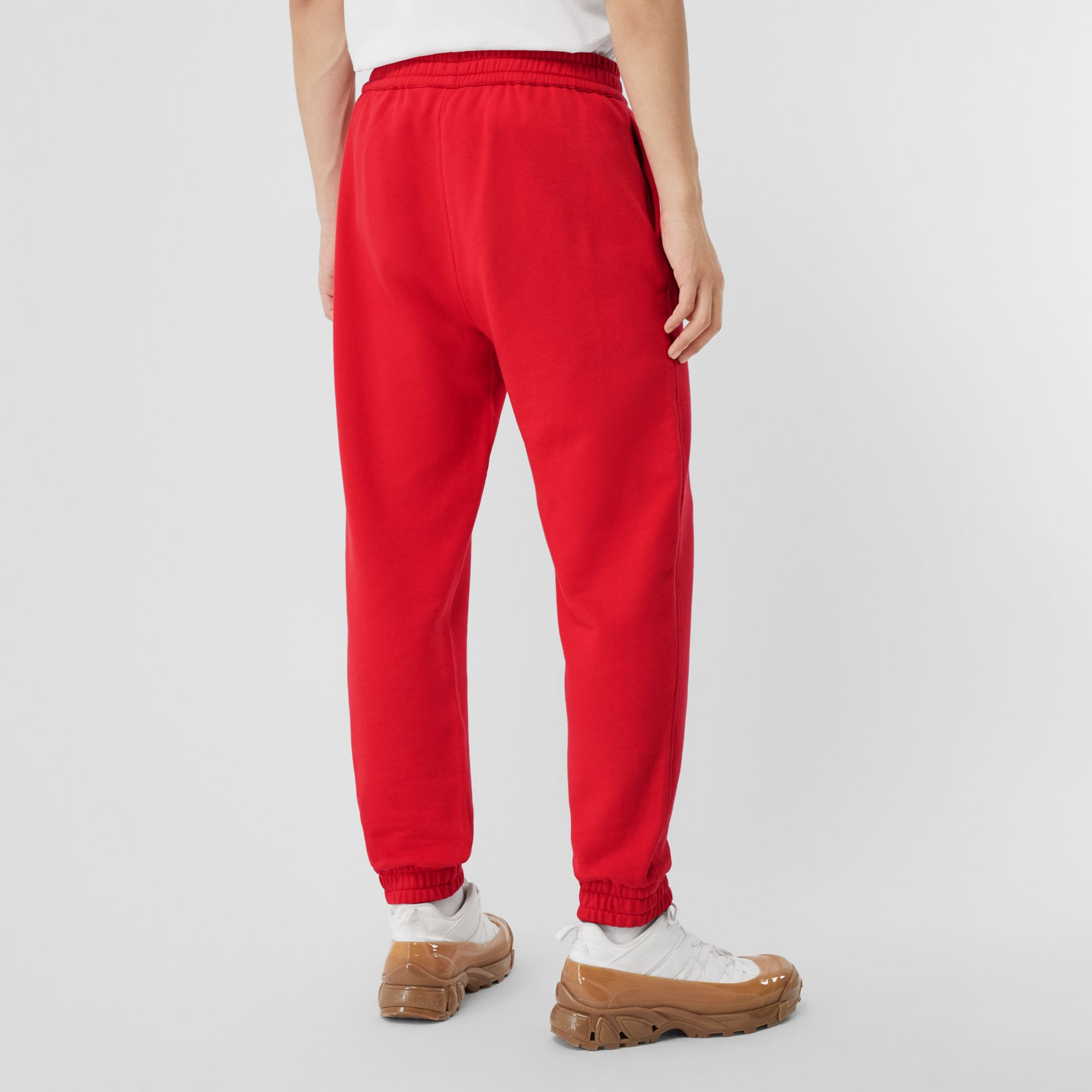 Monogram Motif Cotton Trackpants in Bright Red - Men | Burberry - gallery image 1