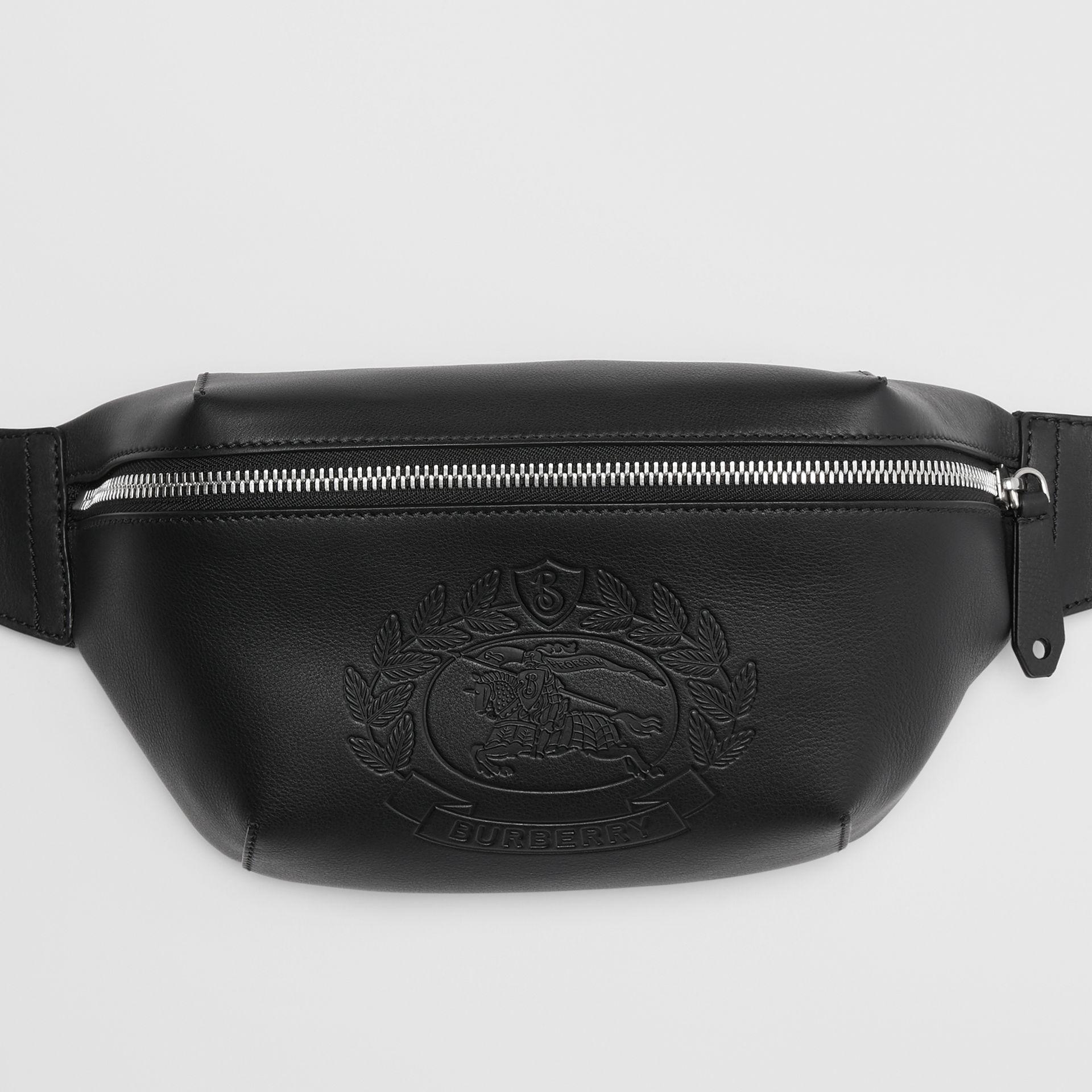 Medium Embossed Crest Leather Bum Bag in Black | Burberry United Kingdom - gallery image 1