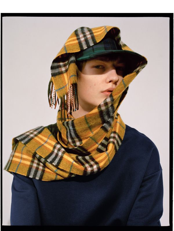 Honza protects in The Classic Check Cashmere Scarf.