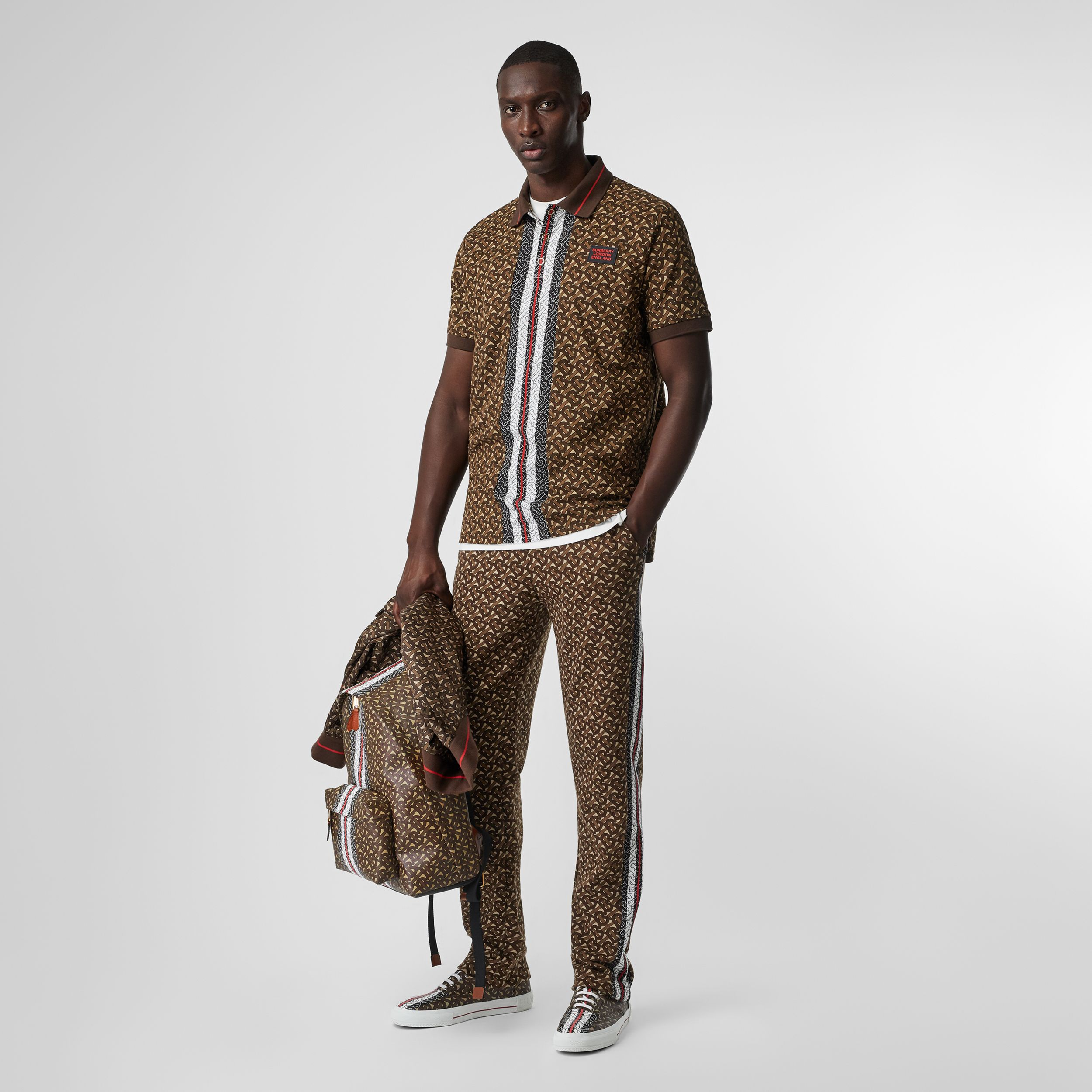 Monogram Stripe Print Cotton Piqué Polo Shirt in Bridle Brown - Men | Burberry Hong Kong S.A.R. - 1