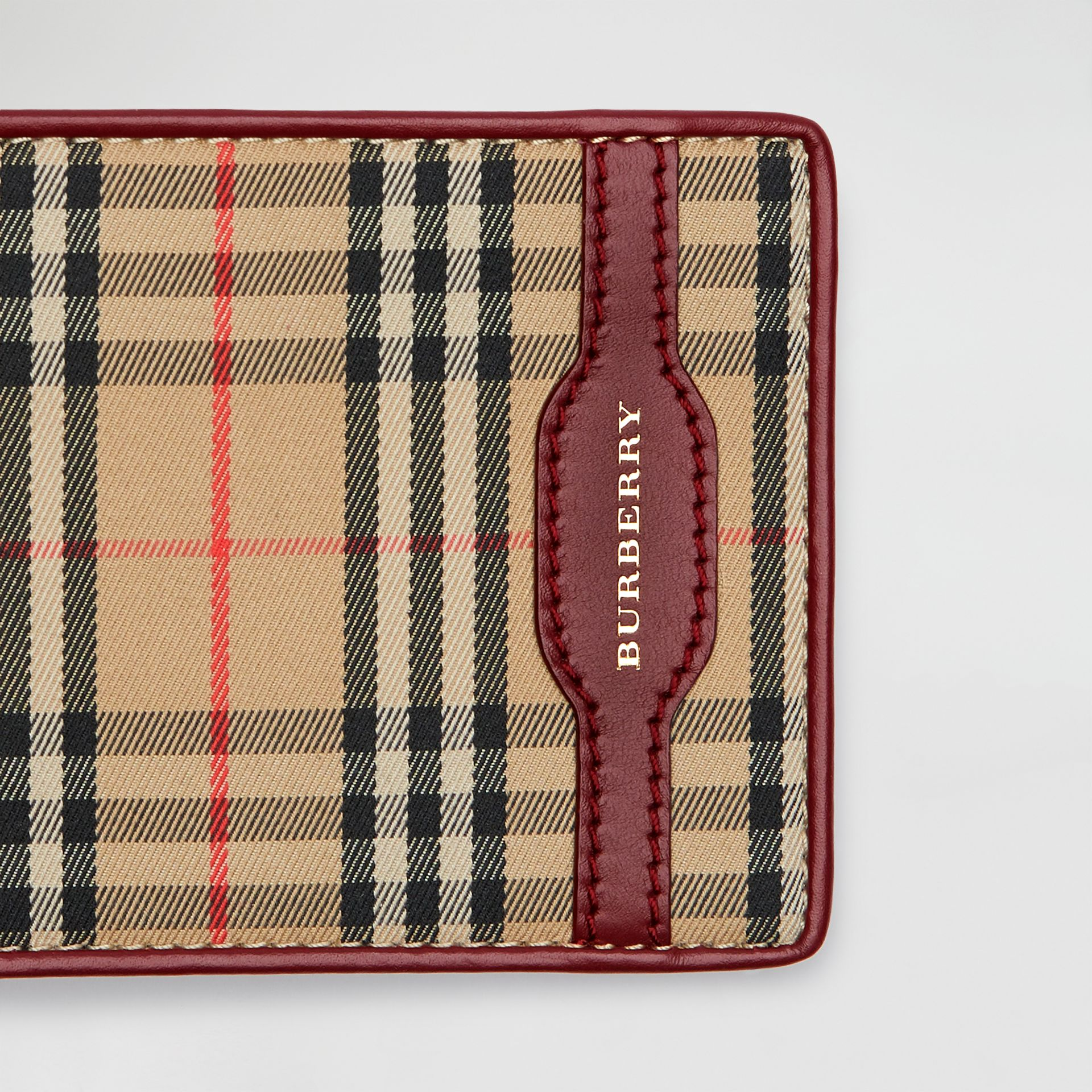 1983 Check and Leather International Bifold Wallet in Antique Red - Men | Burberry Hong Kong - gallery image 1