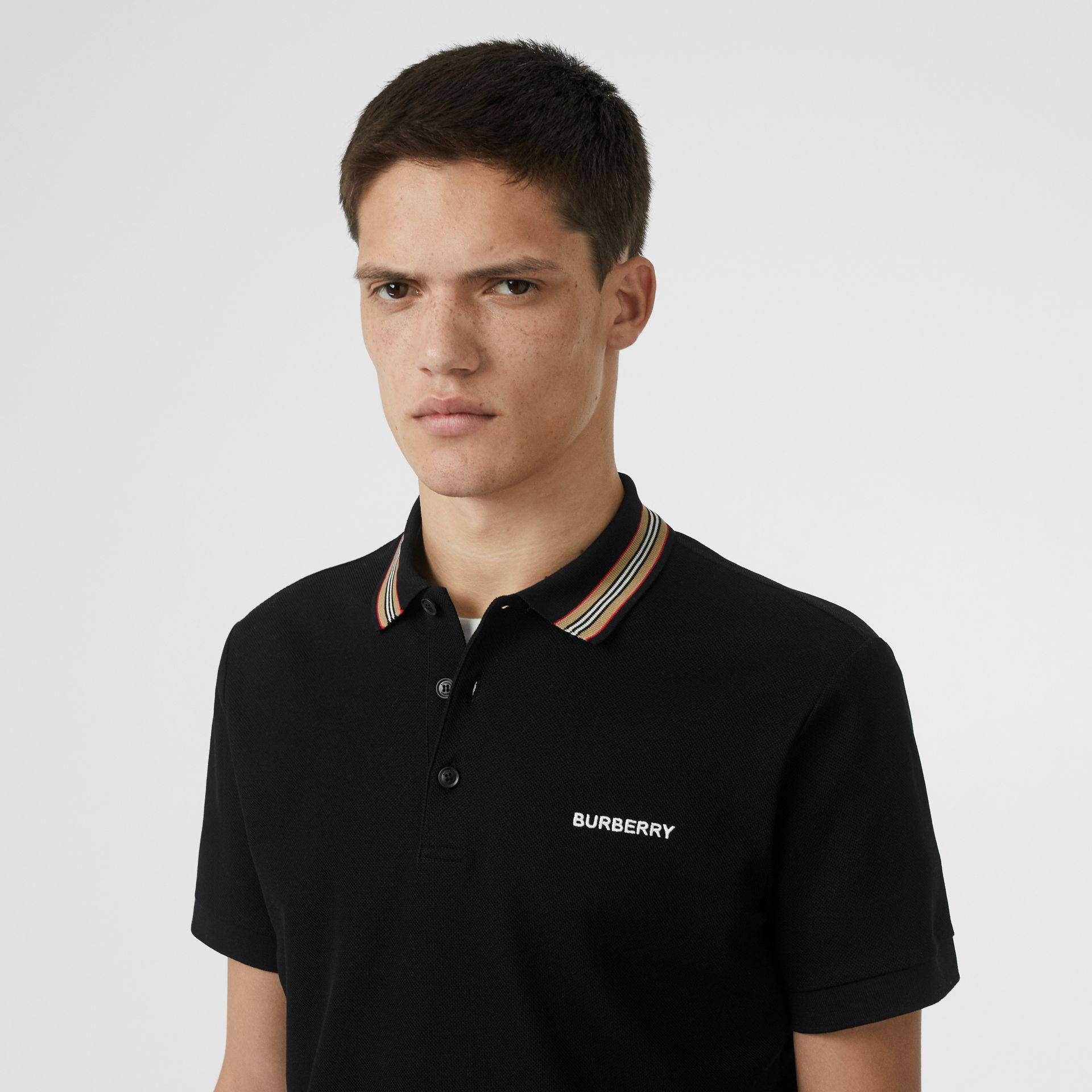 Icon Stripe Detail Cotton Piqué Polo Shirt in Black - Men | Burberry - gallery image 1