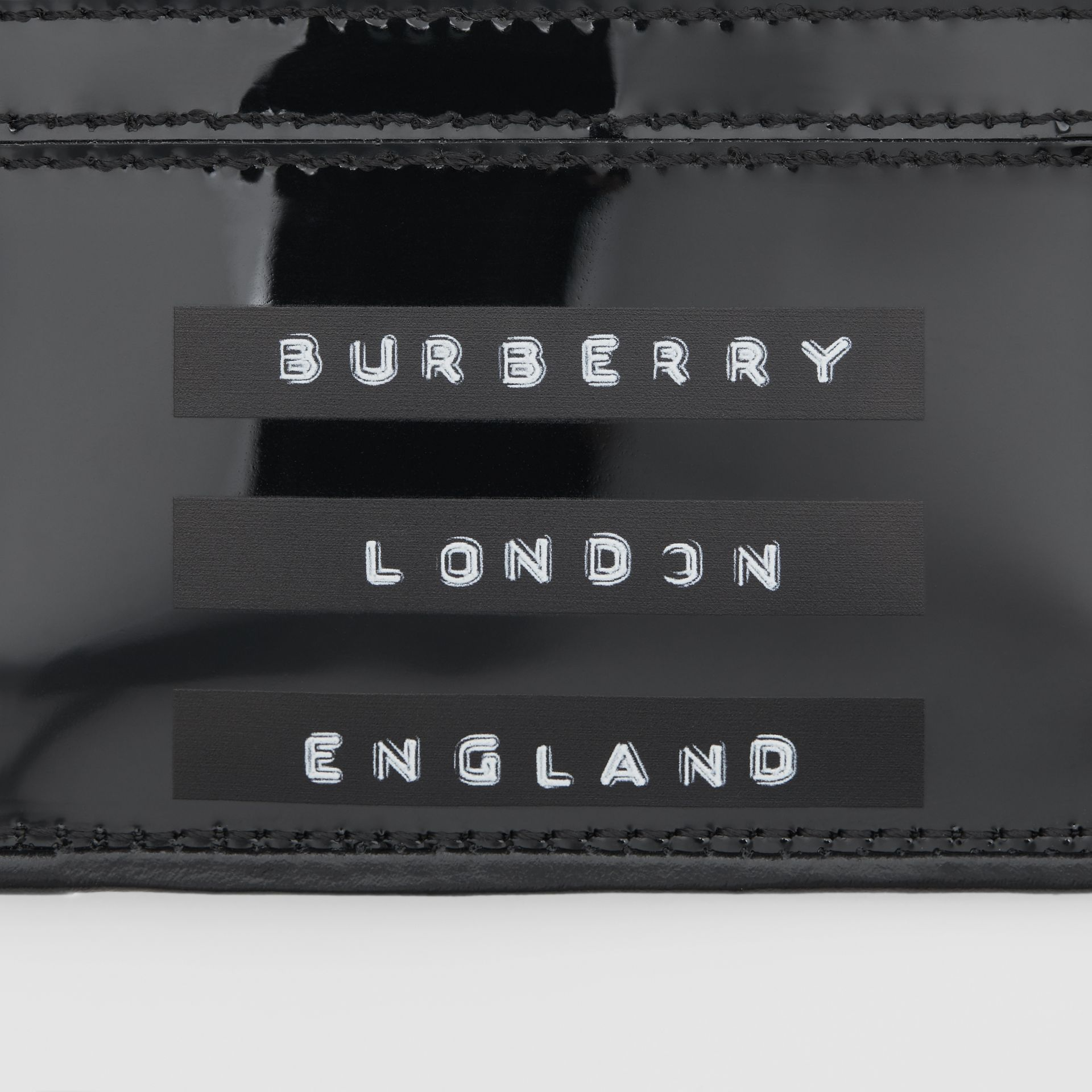 Tape Print Laminated Card Case in Black - Women | Burberry - gallery image 1