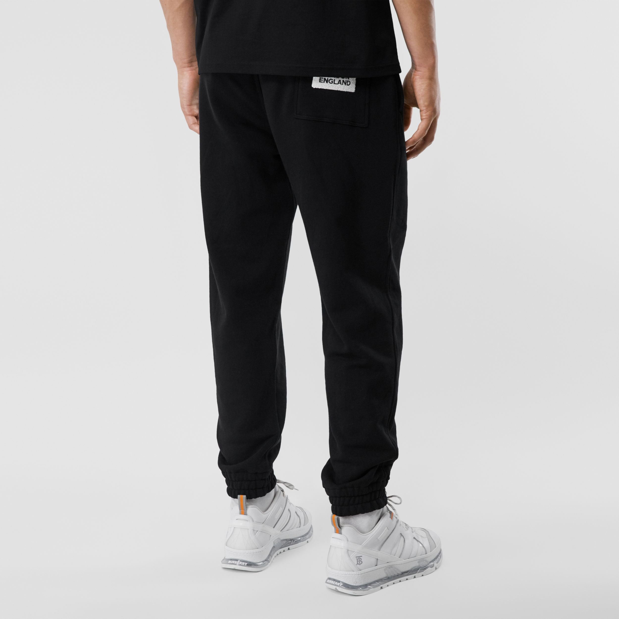 Logo Appliqué Cotton Trackpants in Black - Men | Burberry - 3