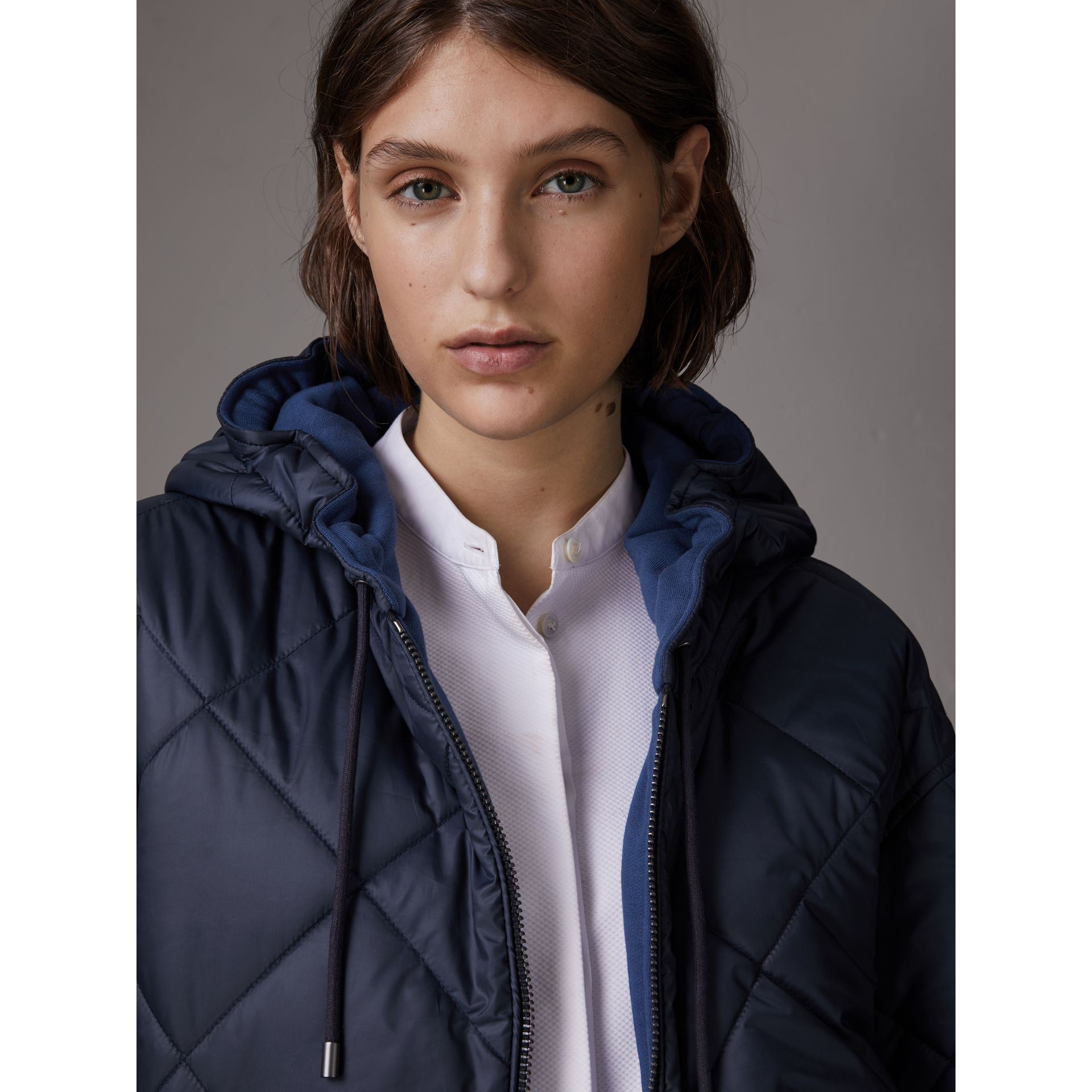 Reversible Diamond Quilted Hooded Jacket in Navy - Women | Burberry - gallery image 1