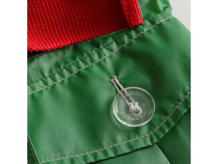 Tape Detail Rain Jacket in Bright Pigment Green - Girl | Burberry - cell image 1