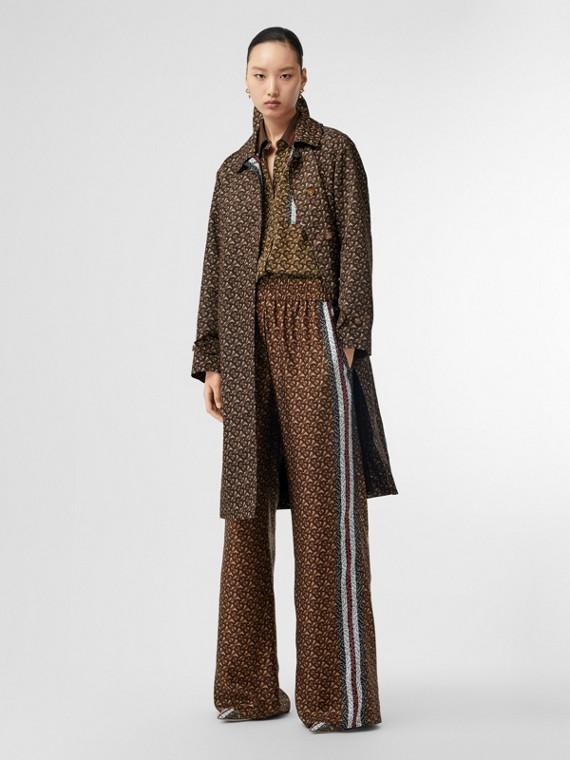 Pantaloni in seta con stampa monogramma e righe verticali (Marrone Redini)