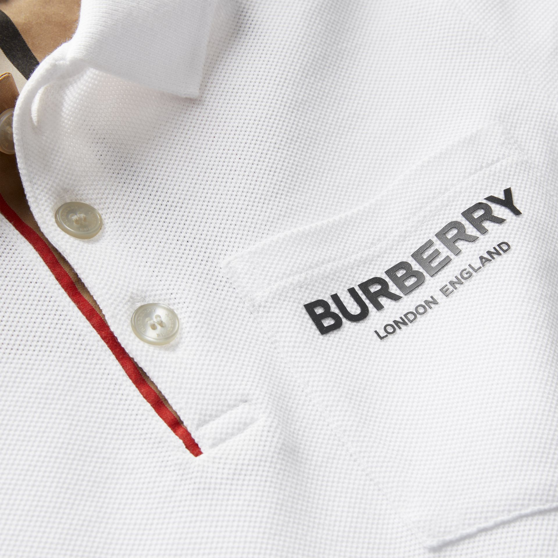 Icon Stripe Placket Cotton Piqué Polo Shirt in White | Burberry Canada - gallery image 1