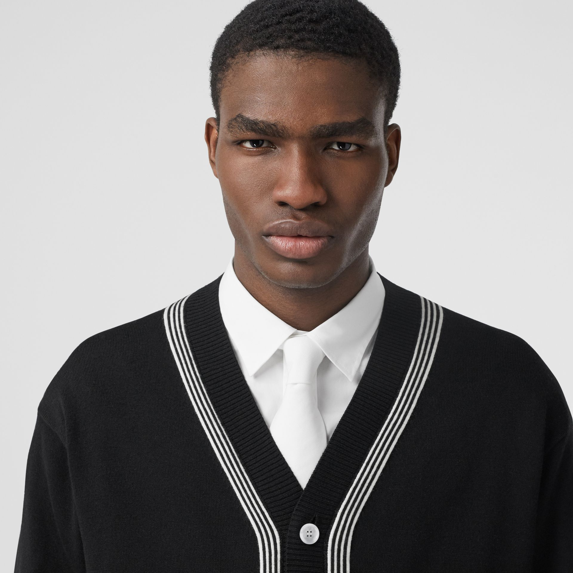 Stripe Detail Merino Wool Oversized Cardigan in Black - Men | Burberry - gallery image 1