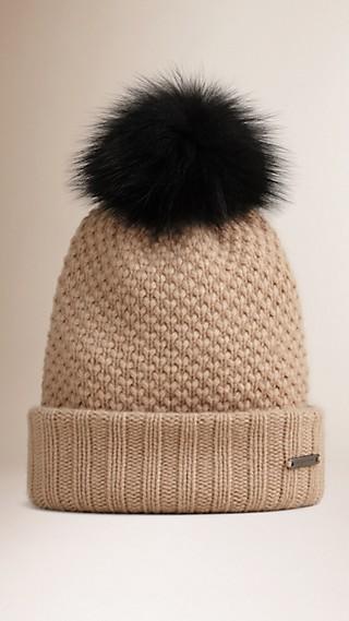 Cappellino in lana e cashmere con pompon in pelliccia