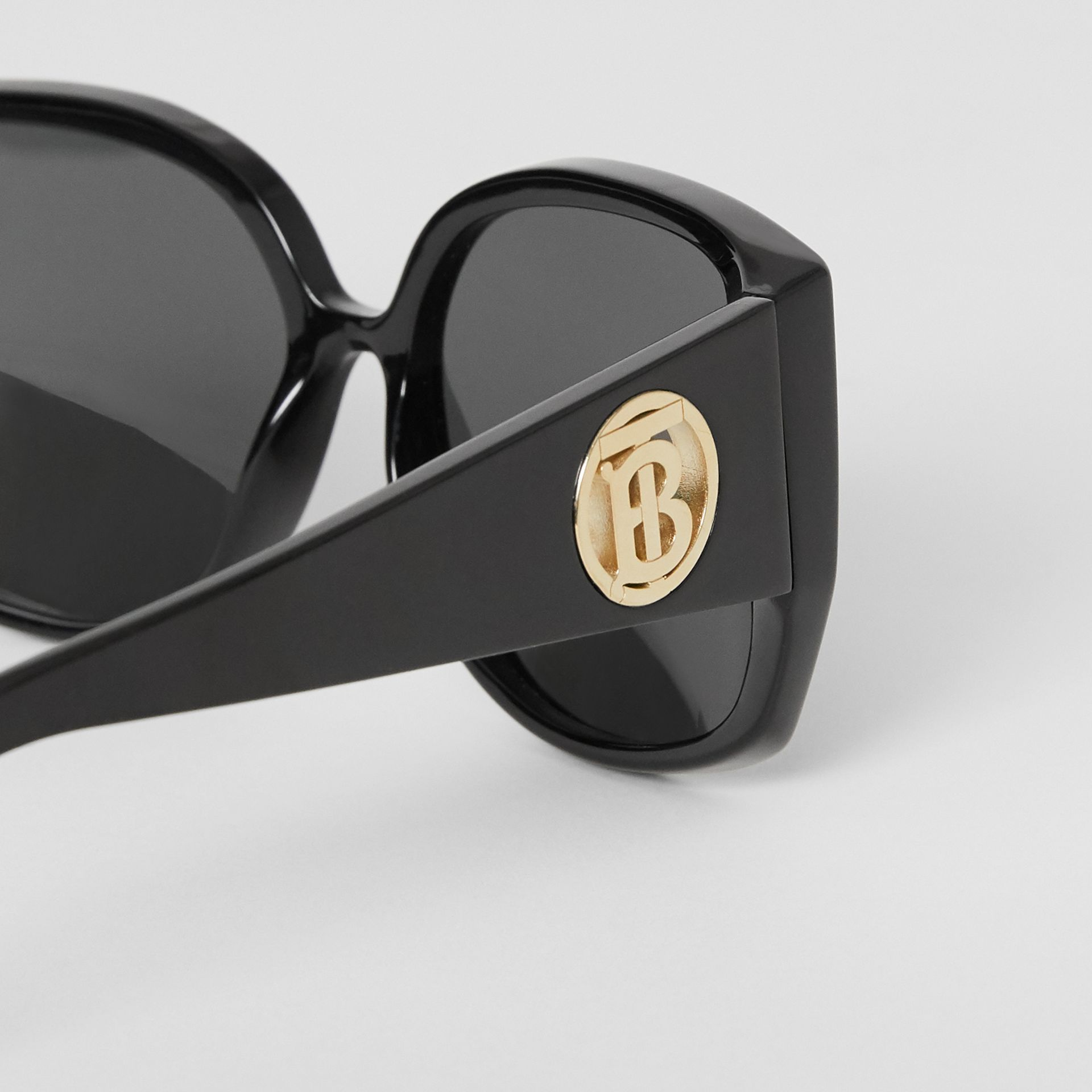 Monogram Detail Round Frame Sunglasses in Black - Women | Burberry - gallery image 1
