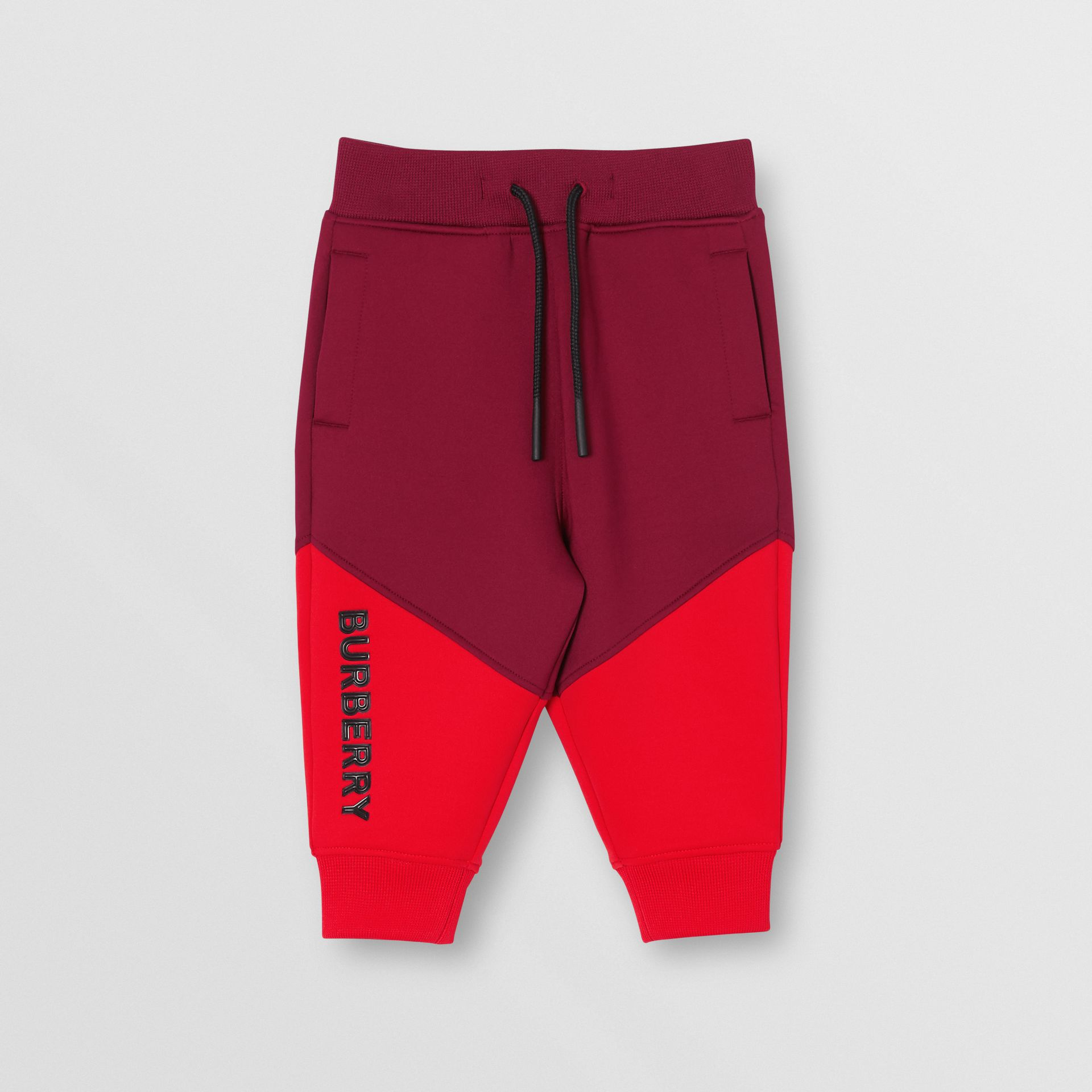 Logo Print Two-tone Stretch Jersey Trackpants in Dark Burgundy - Children | Burberry - gallery image 0
