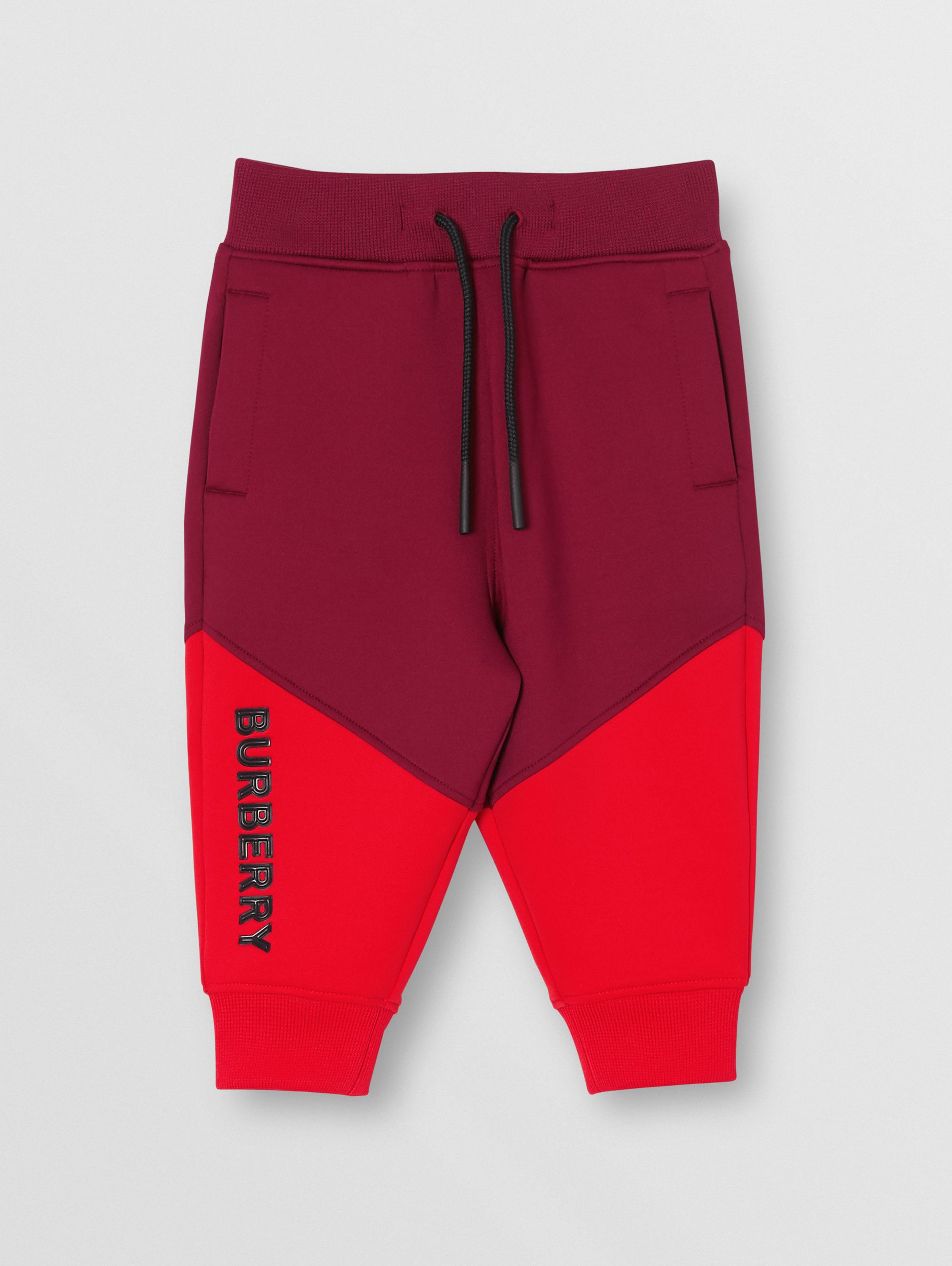 Logo Print Two-tone Stretch Jersey Trackpants in Dark Burgundy - Children | Burberry - 1