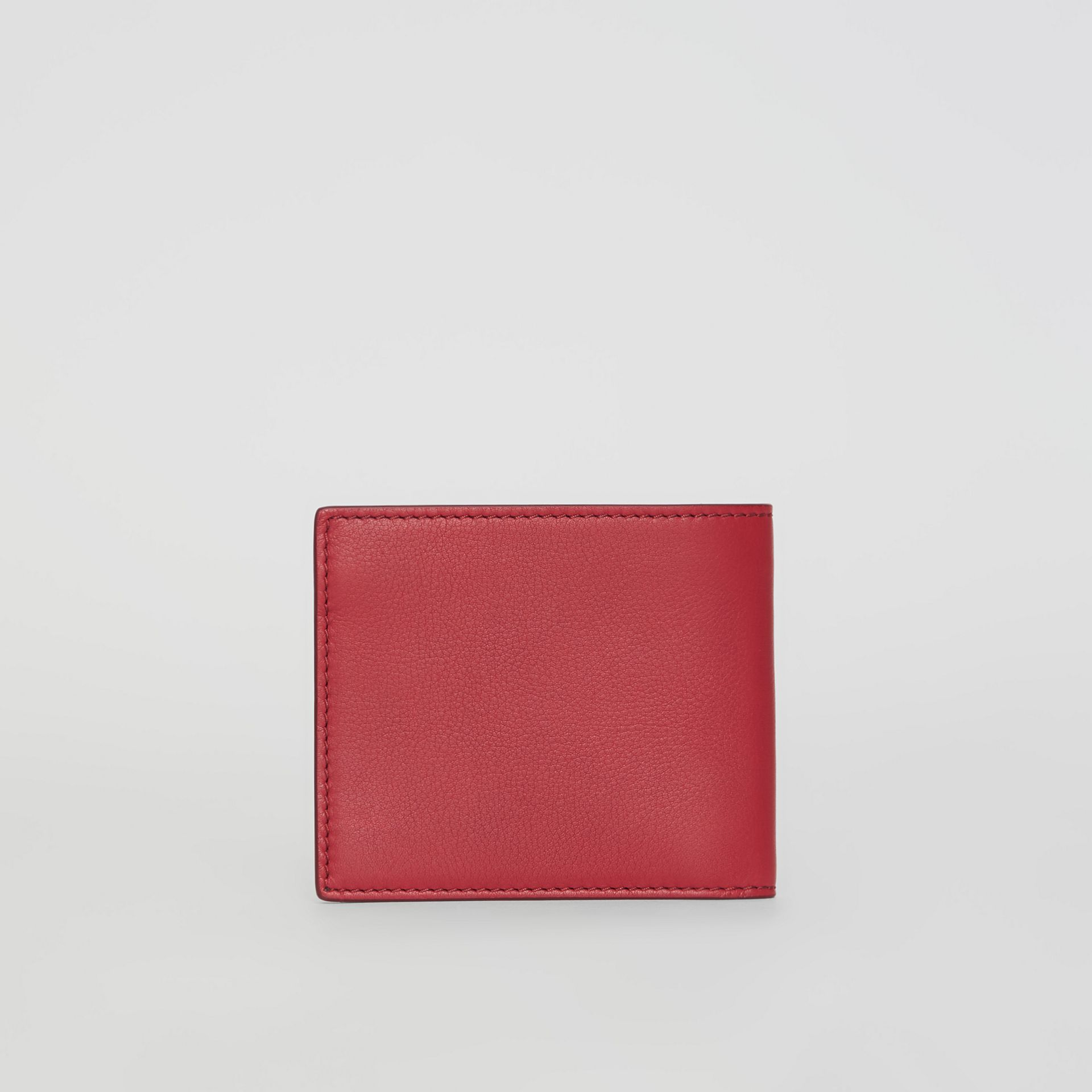 Embossed Crest Leather International Bifold Wallet in Crimson - Men | Burberry Australia - gallery image 2