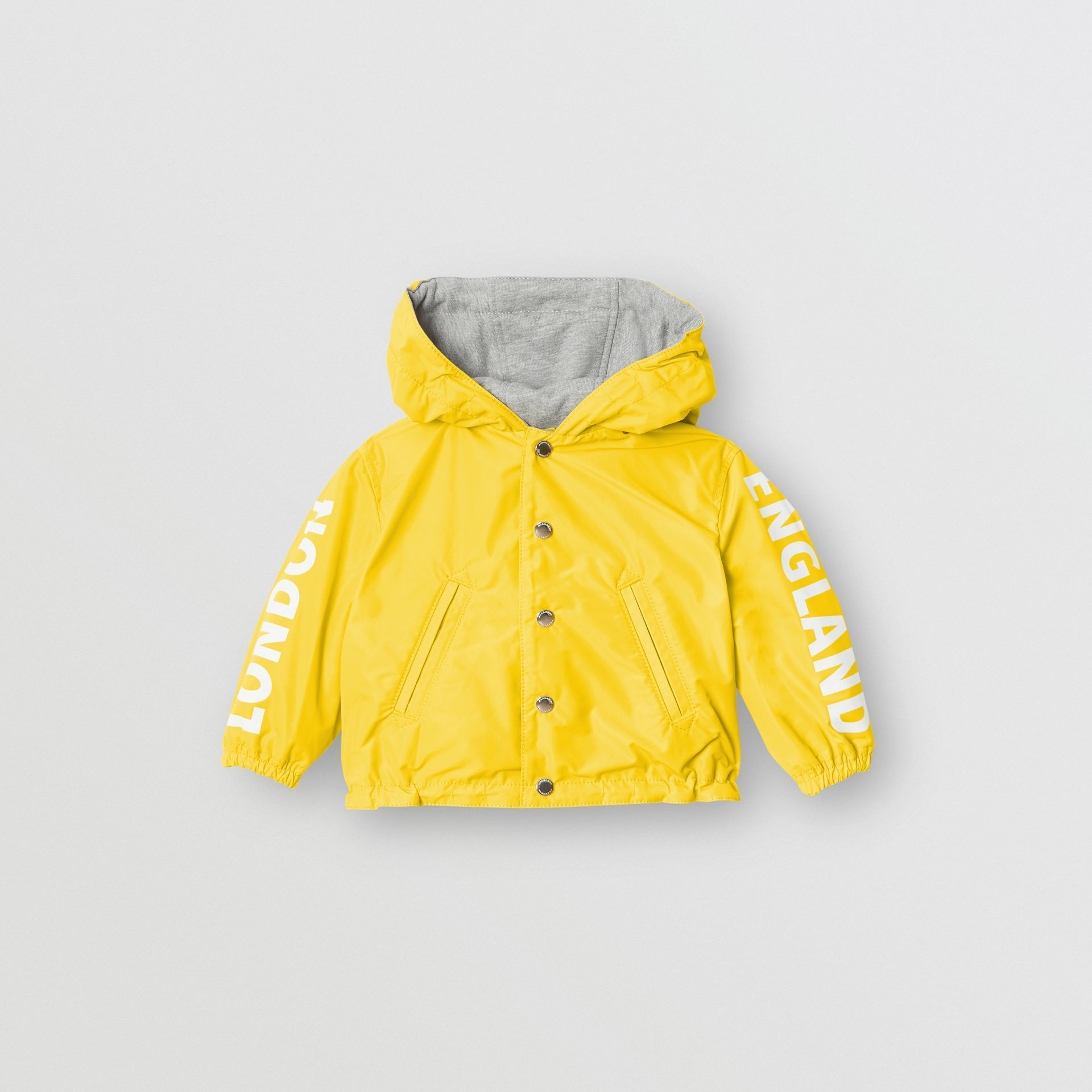 Reversible Logo Print Hooded Jacket in Bright Yellow - Children | Burberry - gallery image 0