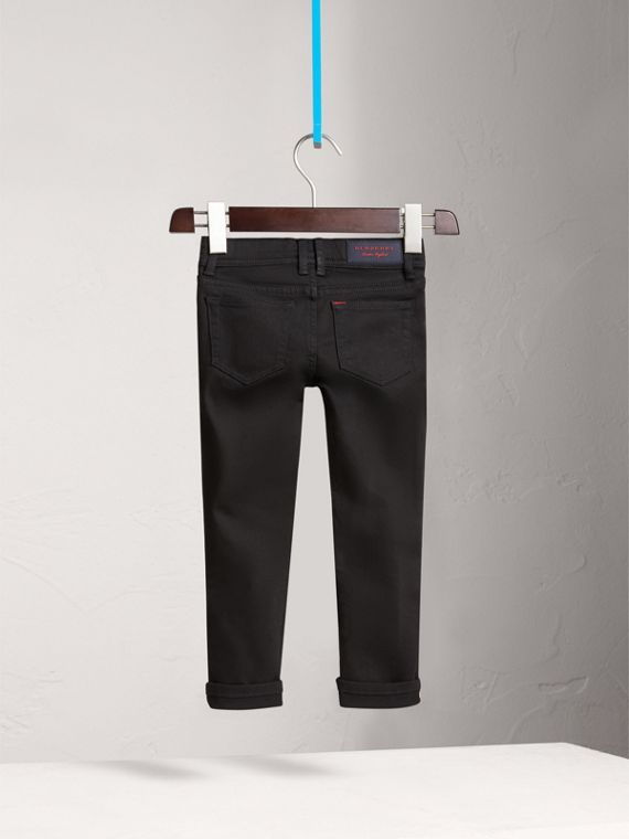 Jeans attillati in denim stretch (Nero) - Bambina | Burberry - cell image 3