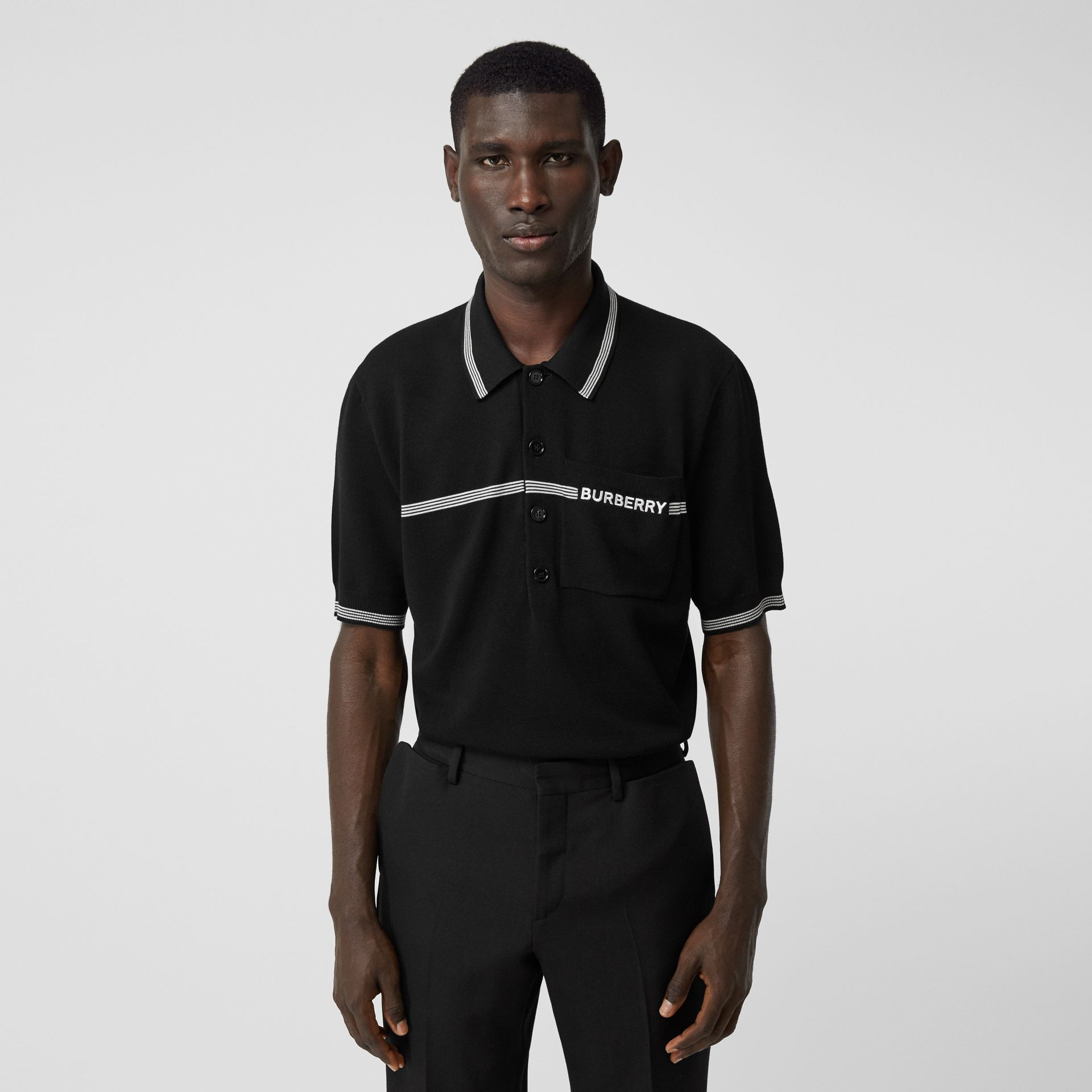 Logo Embroidered Wool Polo Shirt in Black | Burberry - gallery image 0