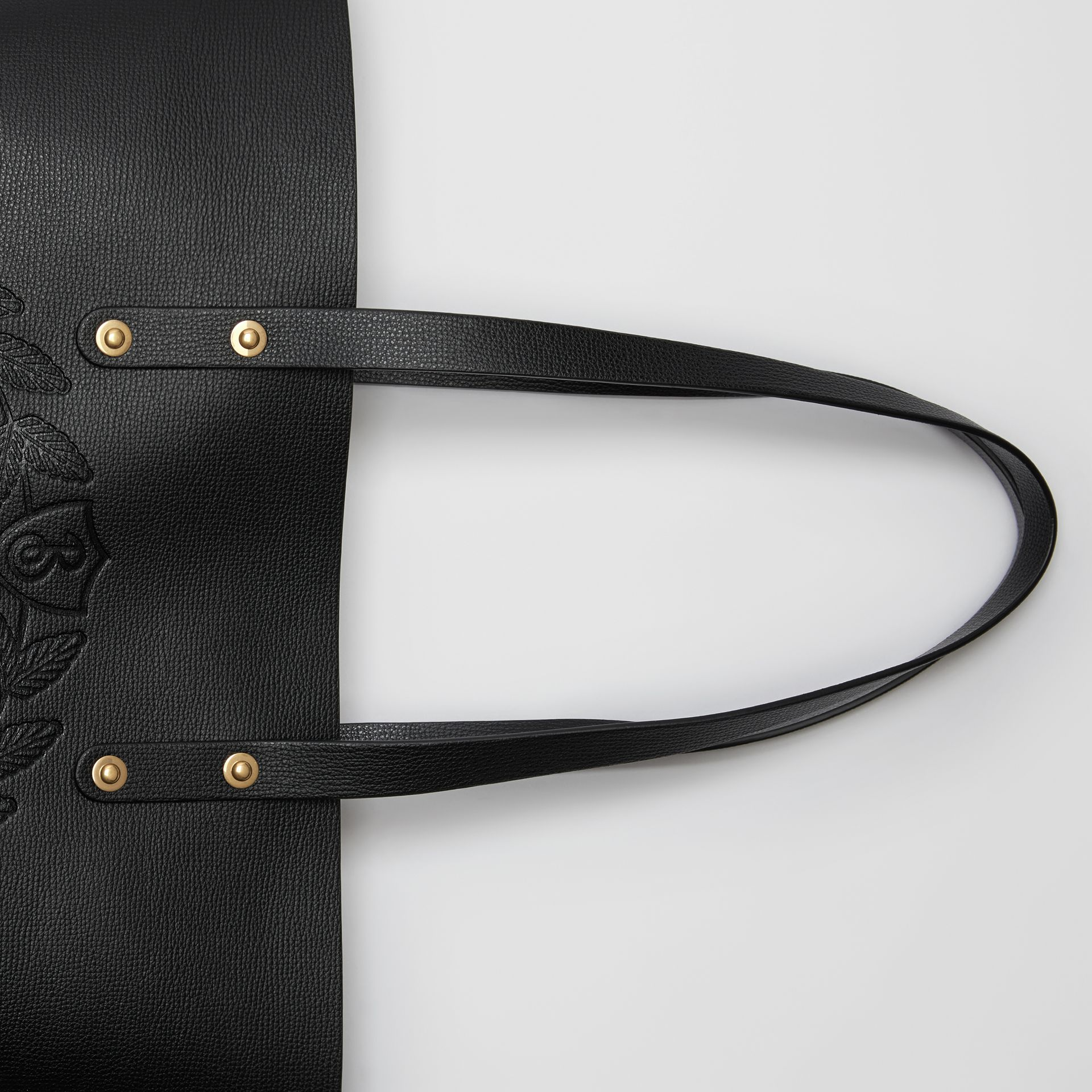 Small Embossed Crest Leather Tote in Black | Burberry - gallery image 1