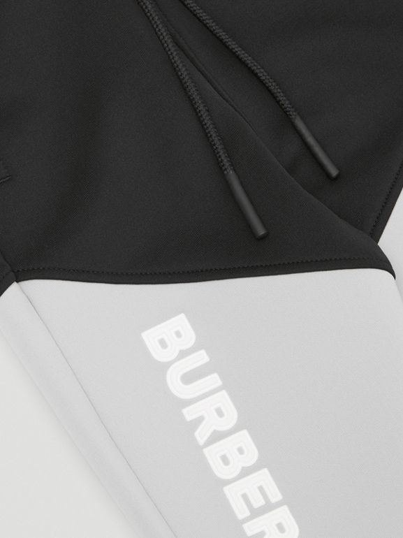 Logo Print Two-tone Stretch Jersey Trackpants in Black - Children | Burberry United States - cell image 1