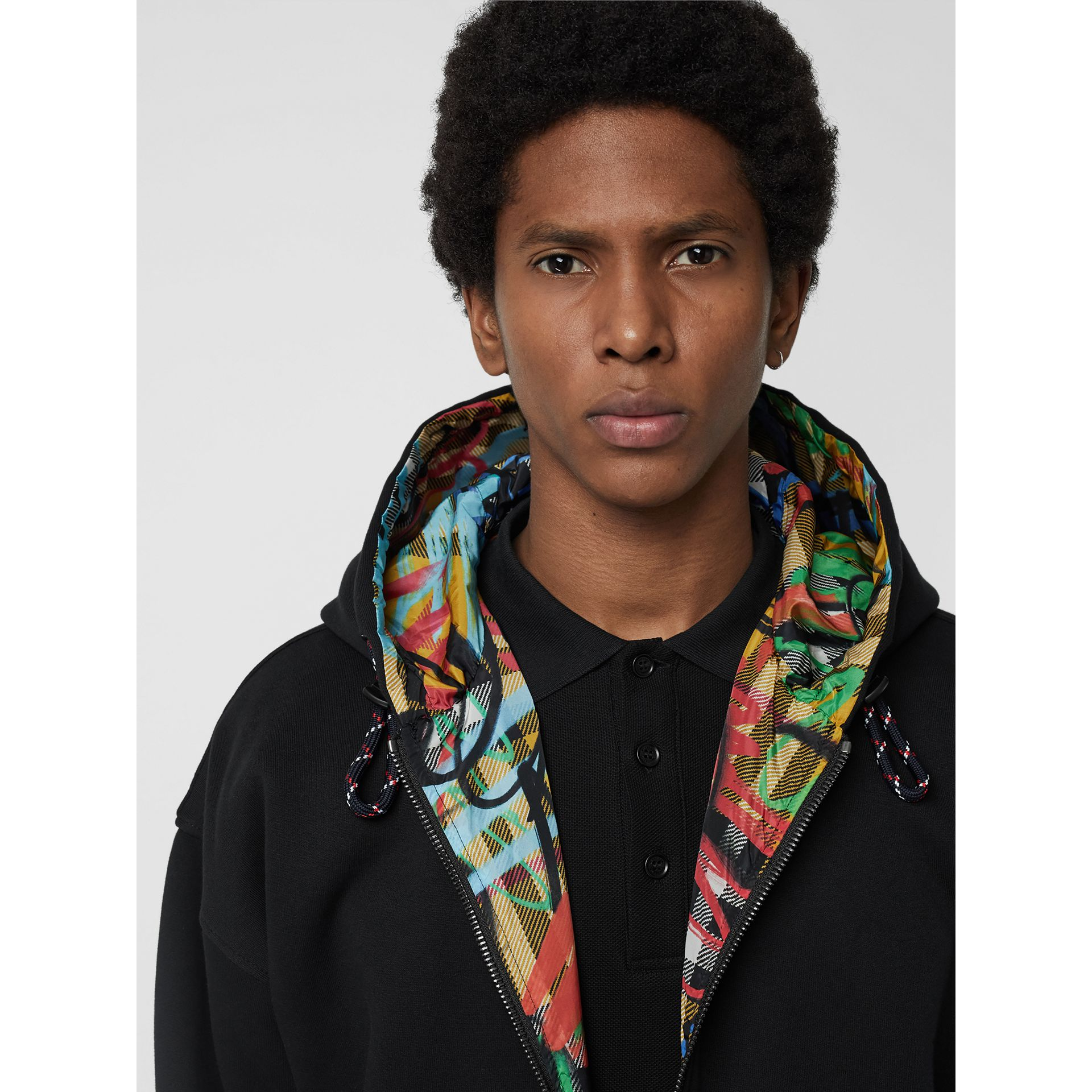 Reversible Graffiti Scribble Check Print Hooded Top in Black - Men | Burberry United States - gallery image 1