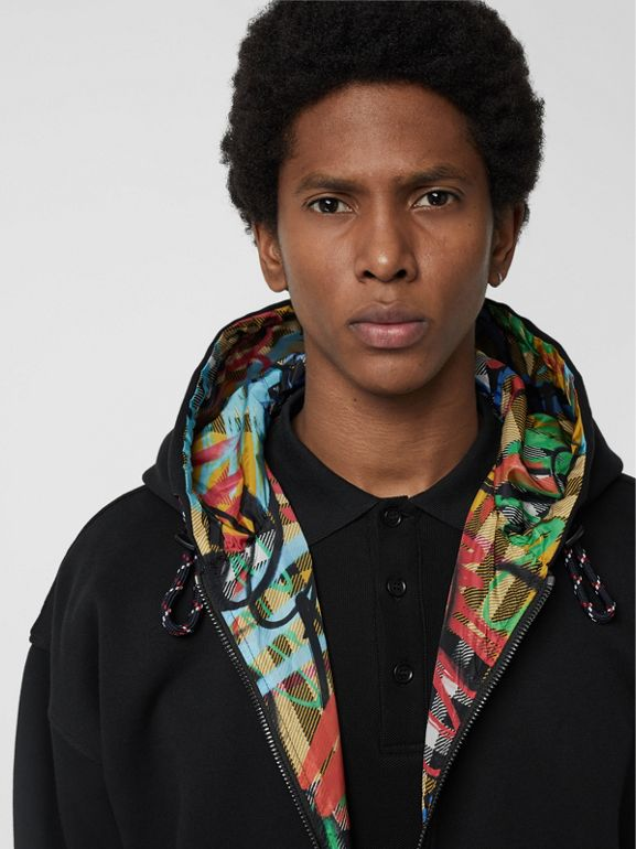 Reversible Graffiti Scribble Check Print Hooded Top in Black - Men | Burberry United States - cell image 1