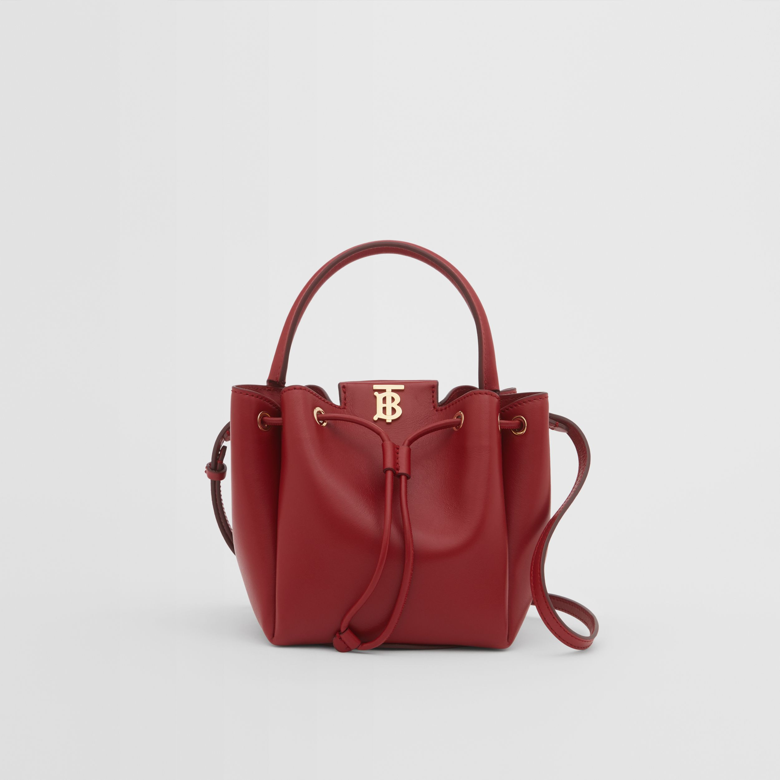 Monogram Motif Leather Bucket Bag in Dark Carmine - Women | Burberry - 1