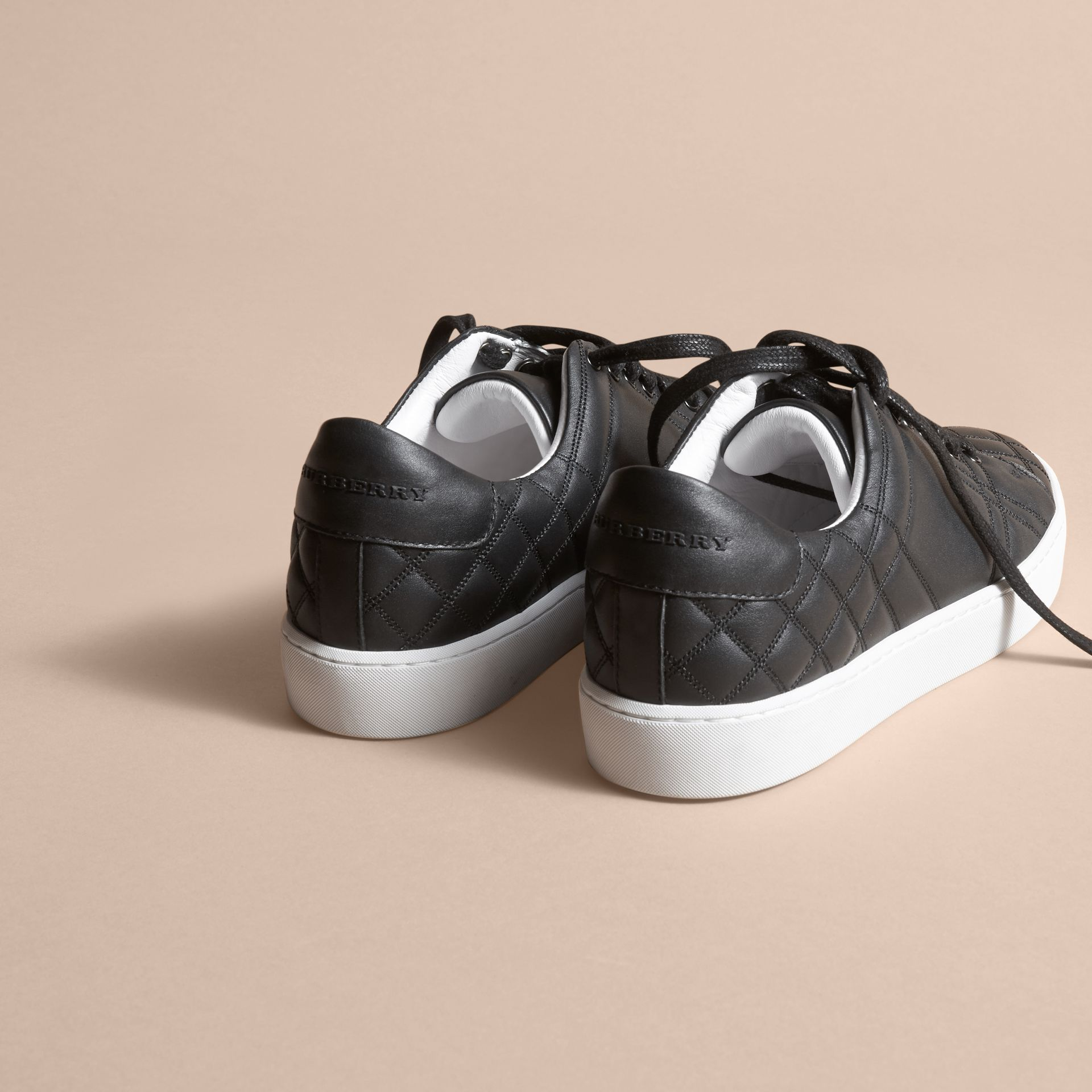 Check-quilted Leather Sneakers in Black - Women | Burberry - gallery image 3
