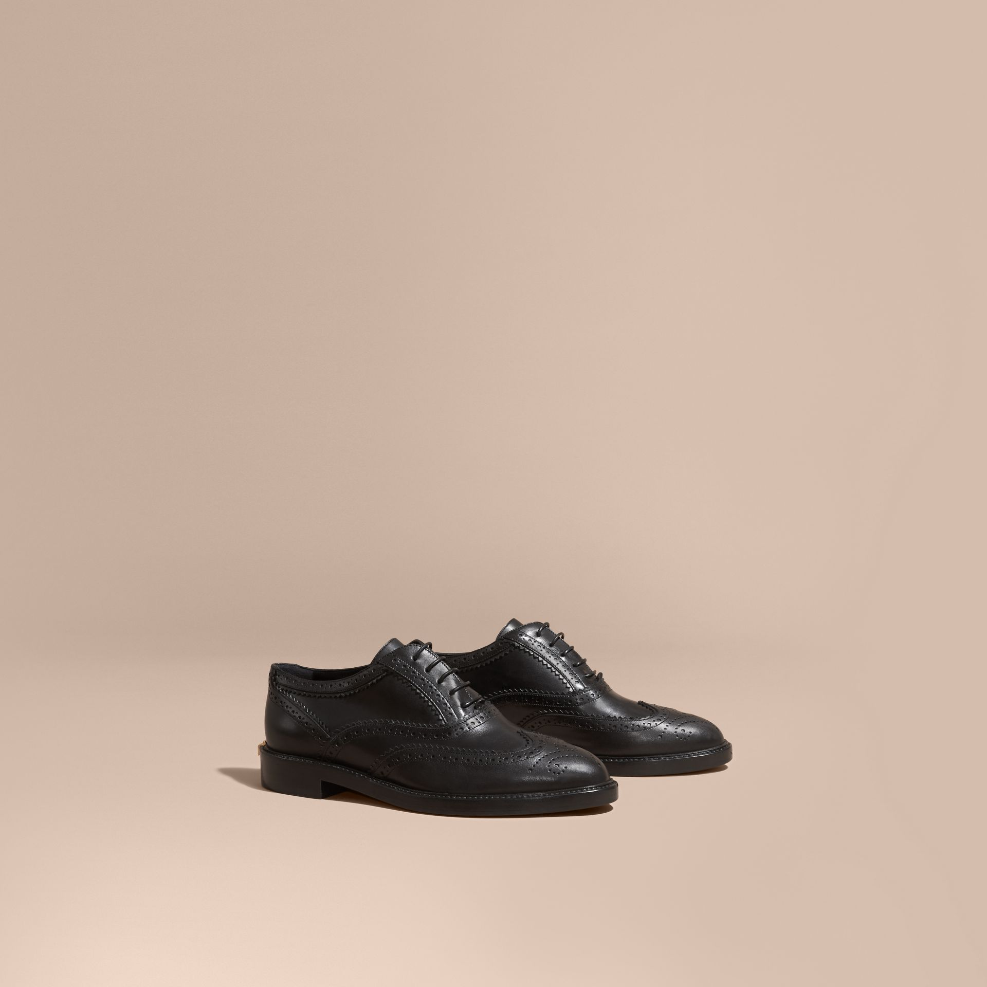 Leather Wingtip Brogues in Black - Women | Burberry - gallery image 1