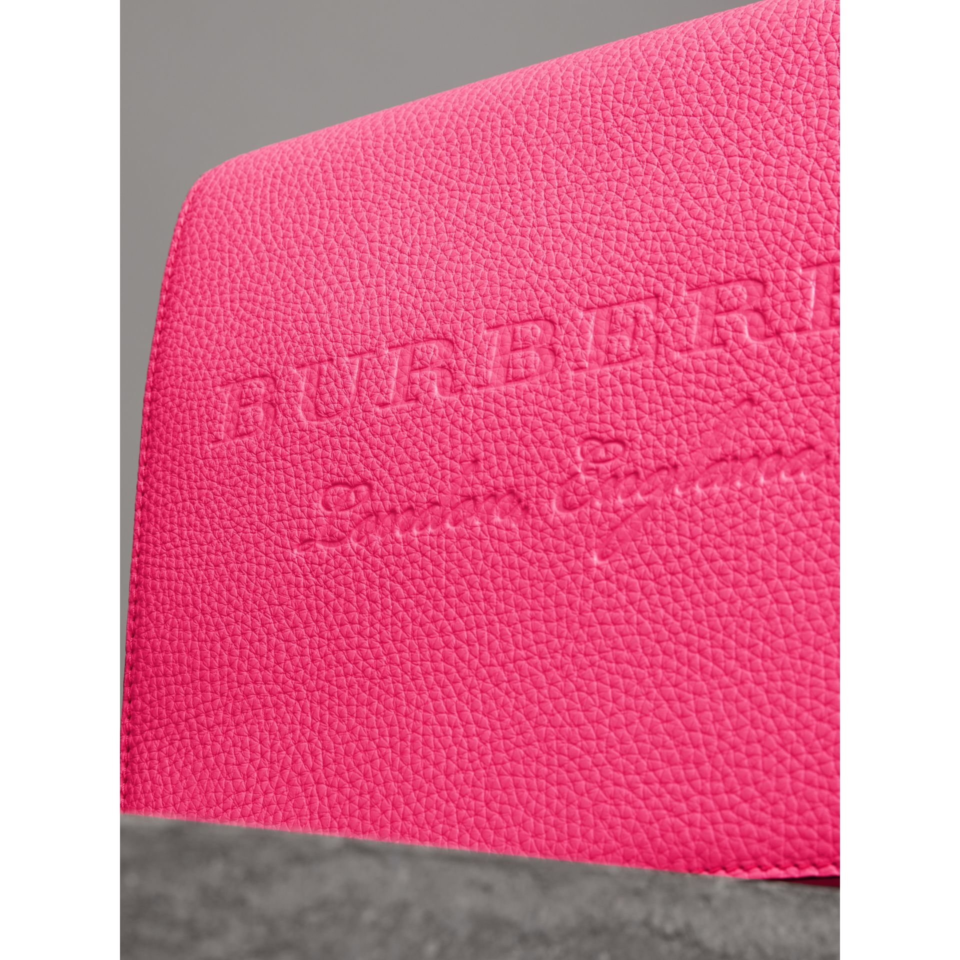 Medium Embossed Leather Messenger Bag in Neon Pink | Burberry - gallery image 1