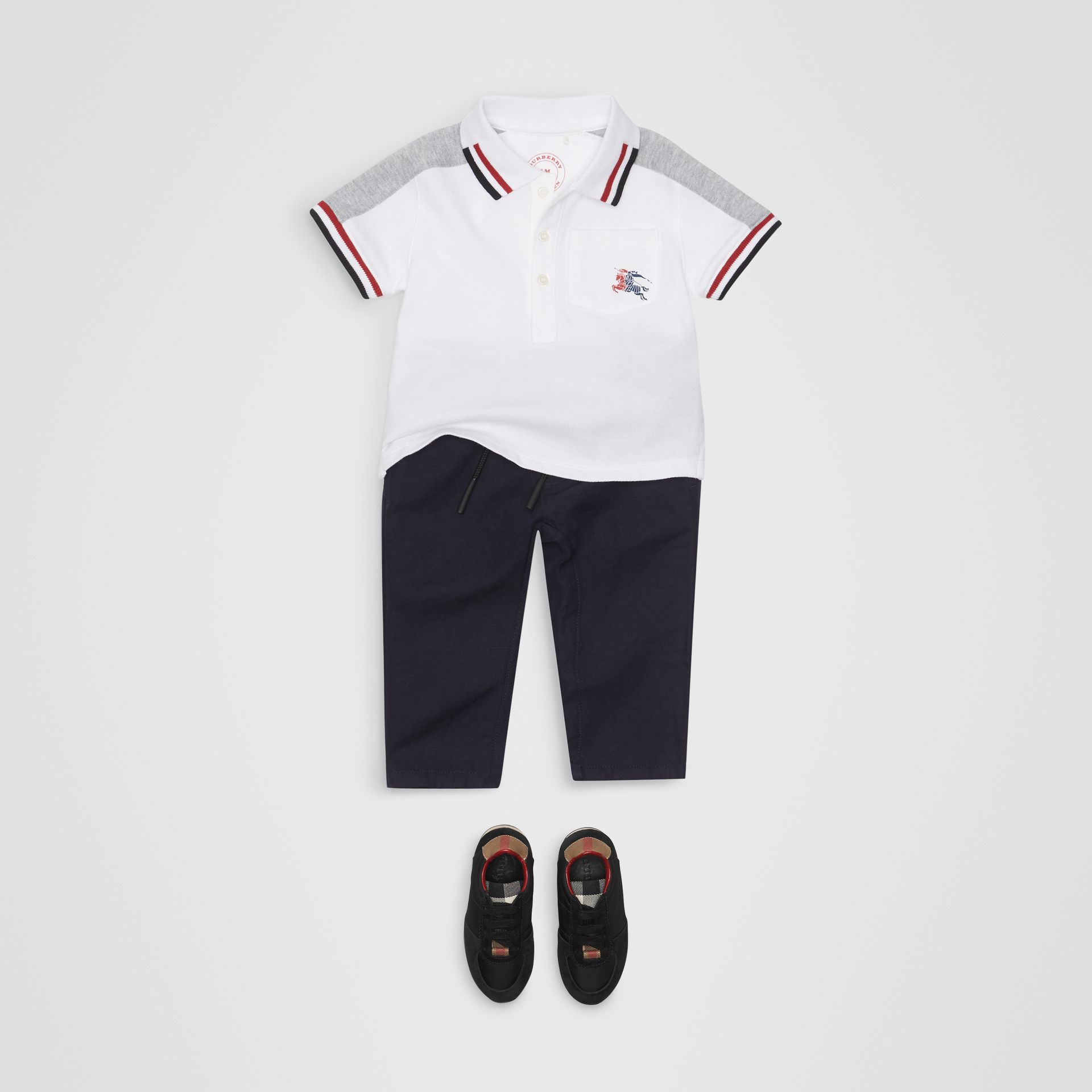Stripe Detail Cotton Piqué Polo Shirt in White - Children | Burberry - gallery image 2