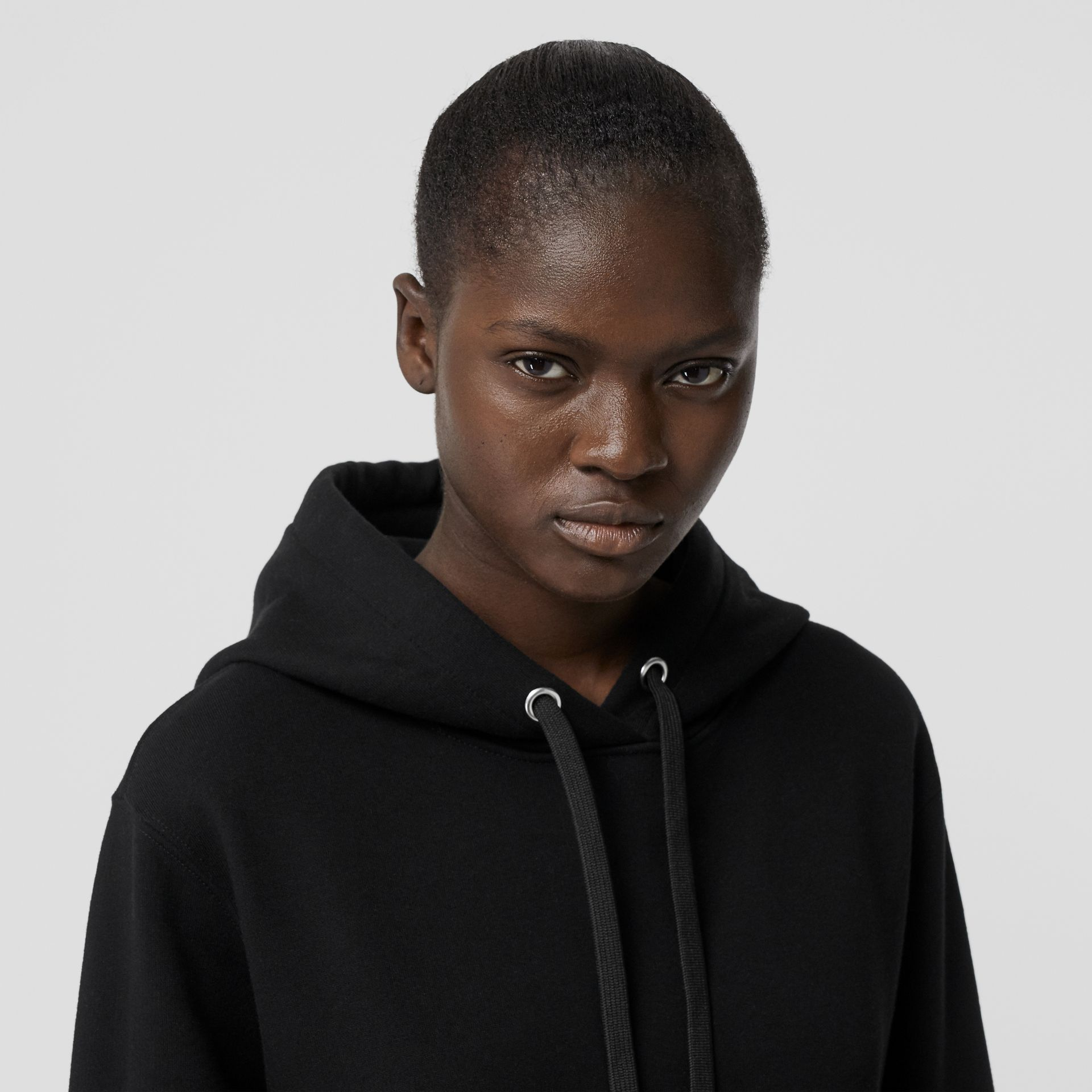 Ring-pierced Cotton Oversized Hoodie in Black - Women | Burberry United Kingdom - gallery image 1