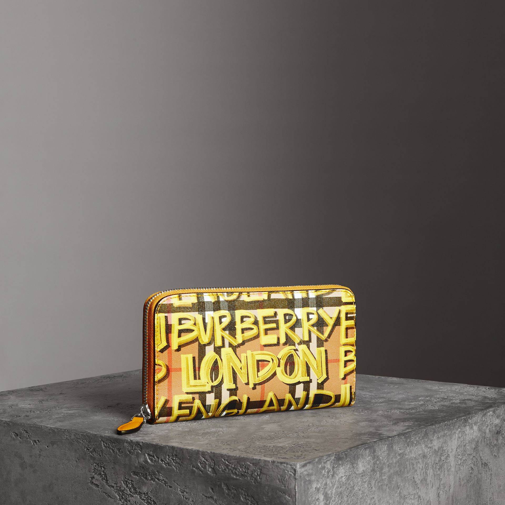 Graffiti Print Vintage Check Leather Ziparound Wallet in Yellow - Women | Burberry - gallery image 0