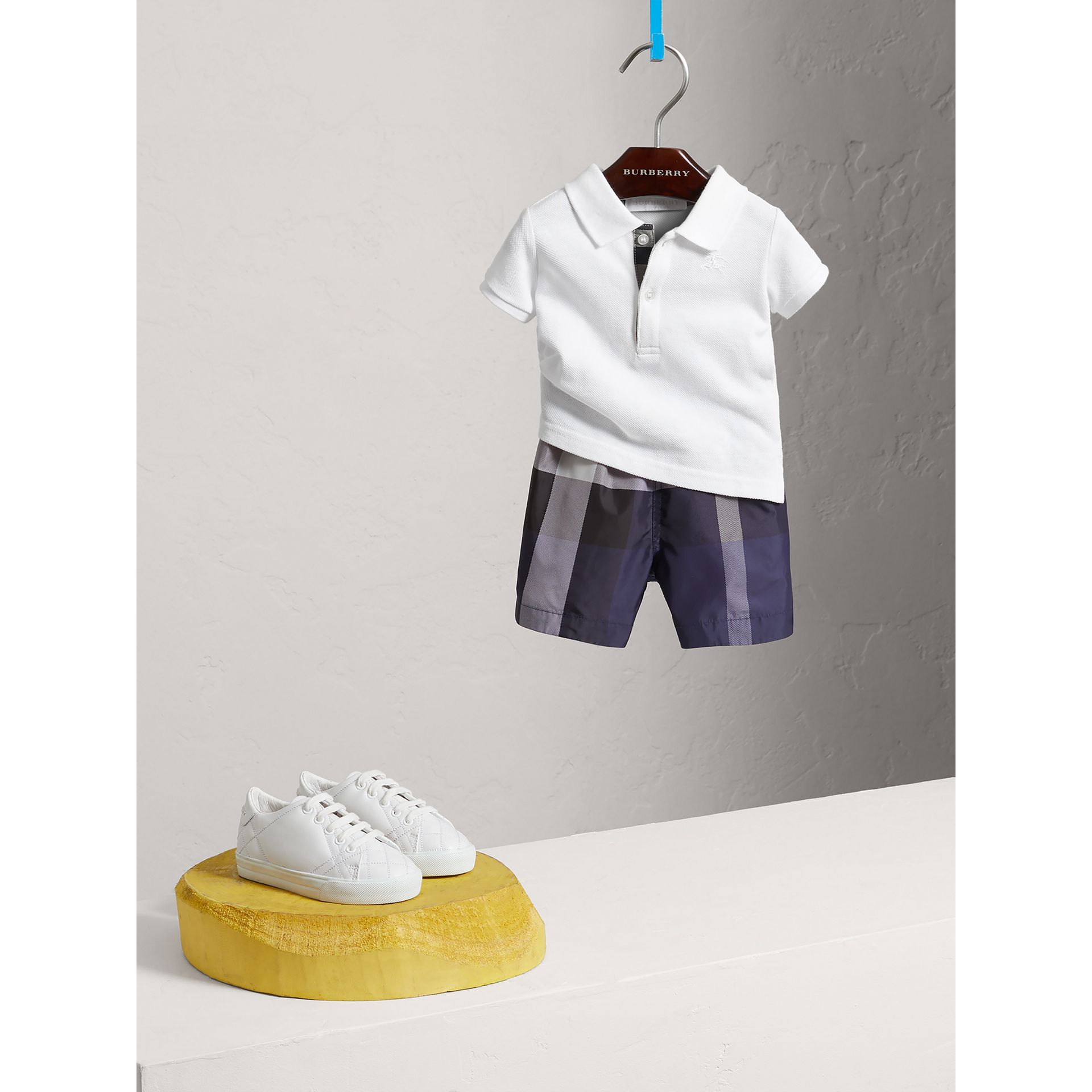 Cotton Piqué Polo Shirt in White | Burberry Singapore - gallery image 0