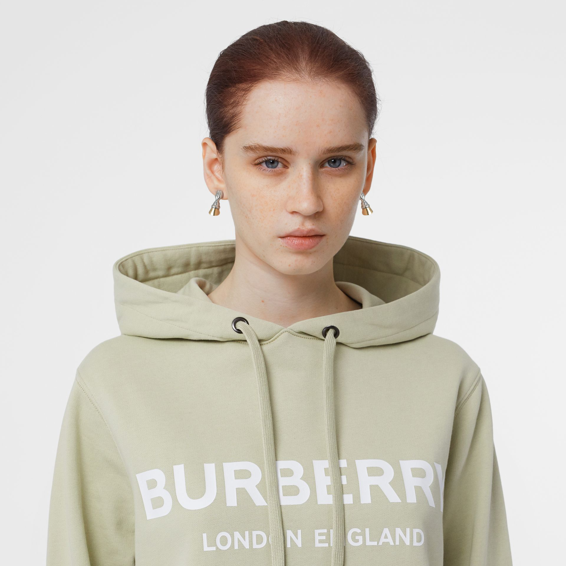 Logo Print Cotton Oversized Hoodie in Pale Apple Green - Women | Burberry United Kingdom - gallery image 1