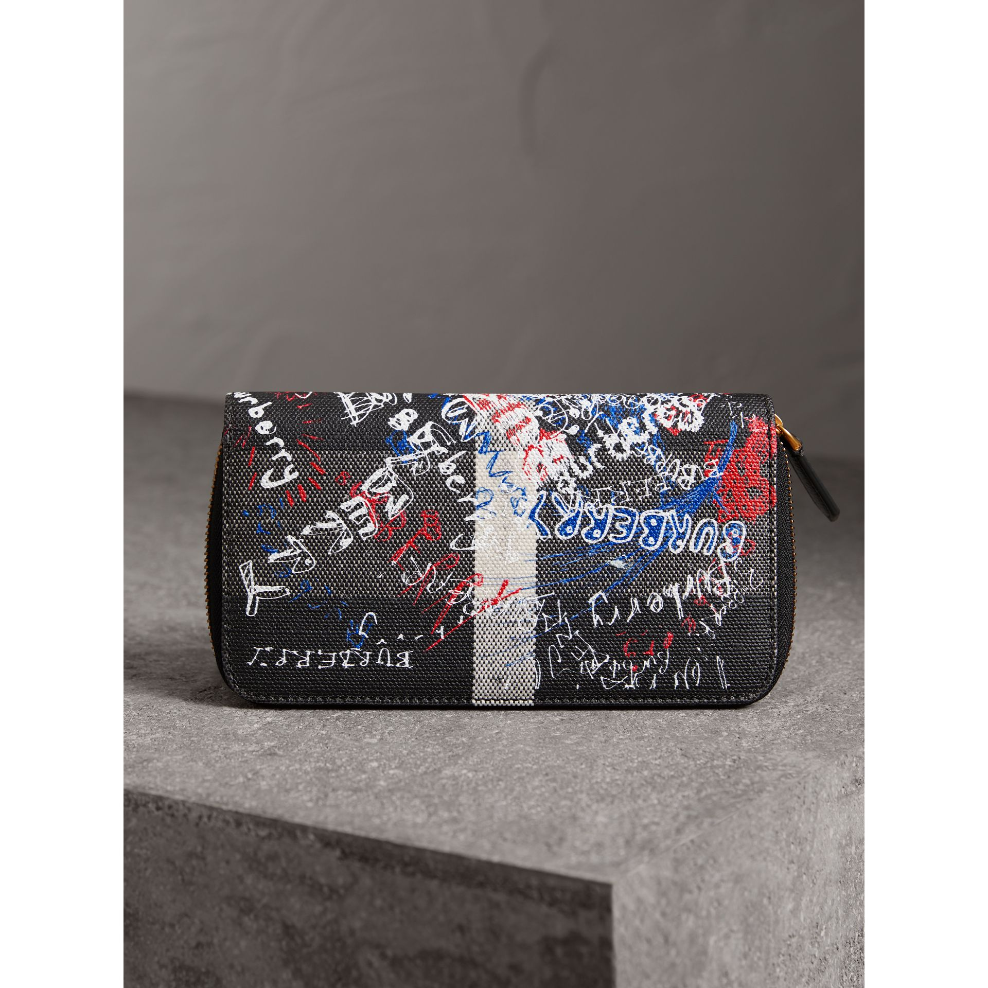 Doodle Print Coated Canvas Ziparound Wallet in Black | Burberry - gallery image 2
