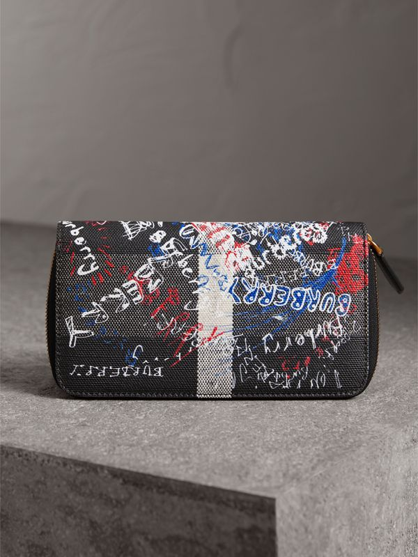 Doodle Print Coated Canvas Ziparound Wallet in Black | Burberry - cell image 2