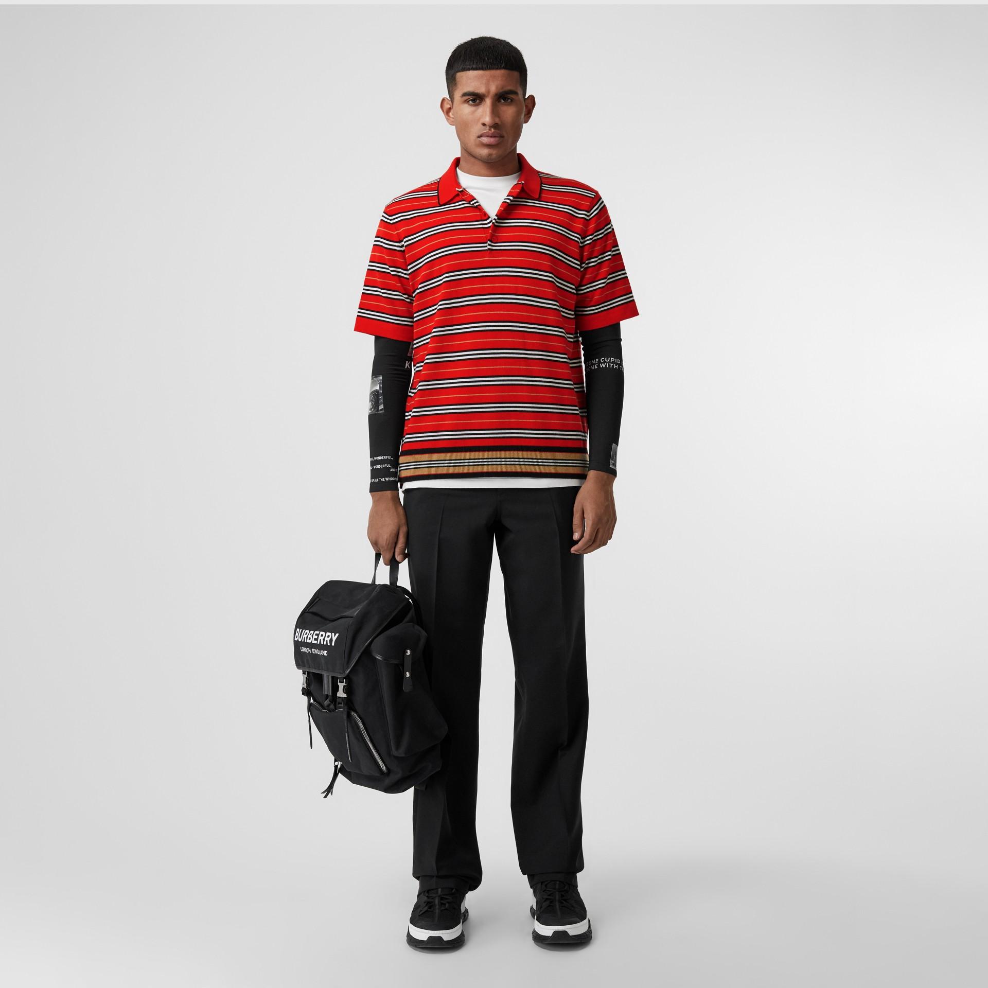Polo en lana de merino a rayas contrastantes (Rojo Intenso) - Hombre | Burberry - imagen de la galería 0
