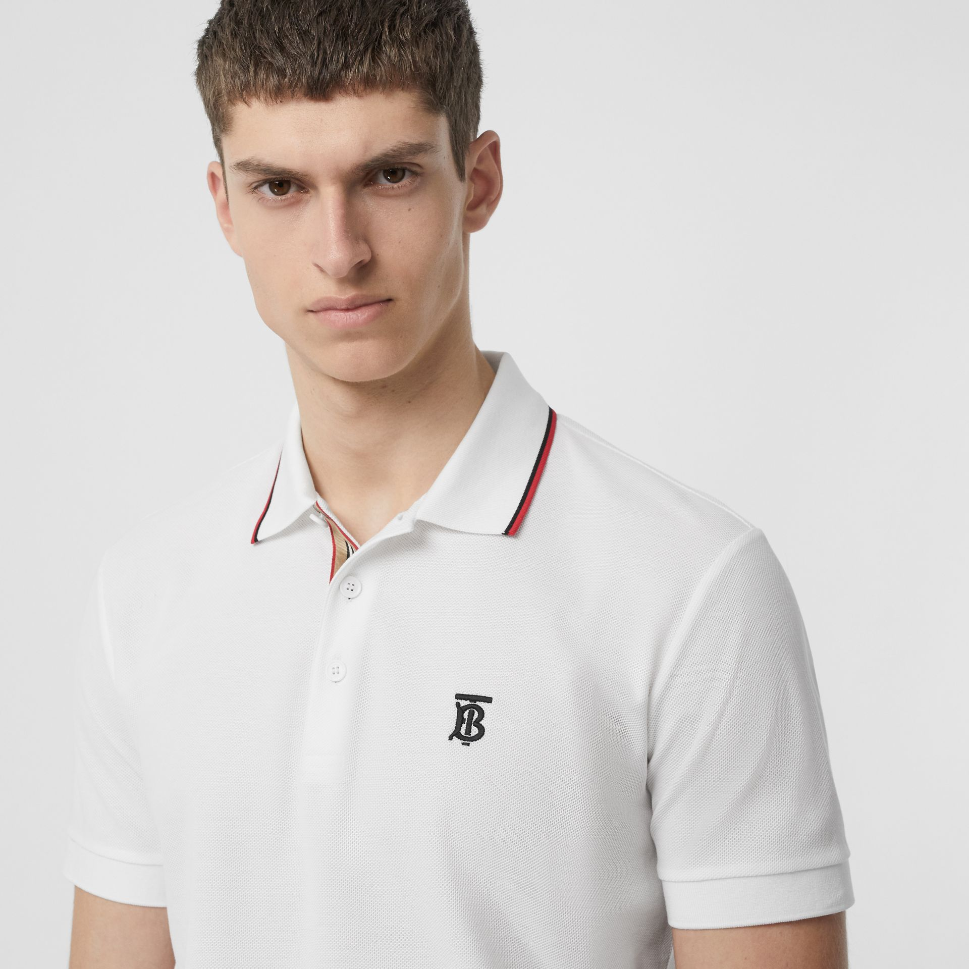 Icon Stripe Placket Cotton Piqué Polo Shirt in White - Men | Burberry - gallery image 1