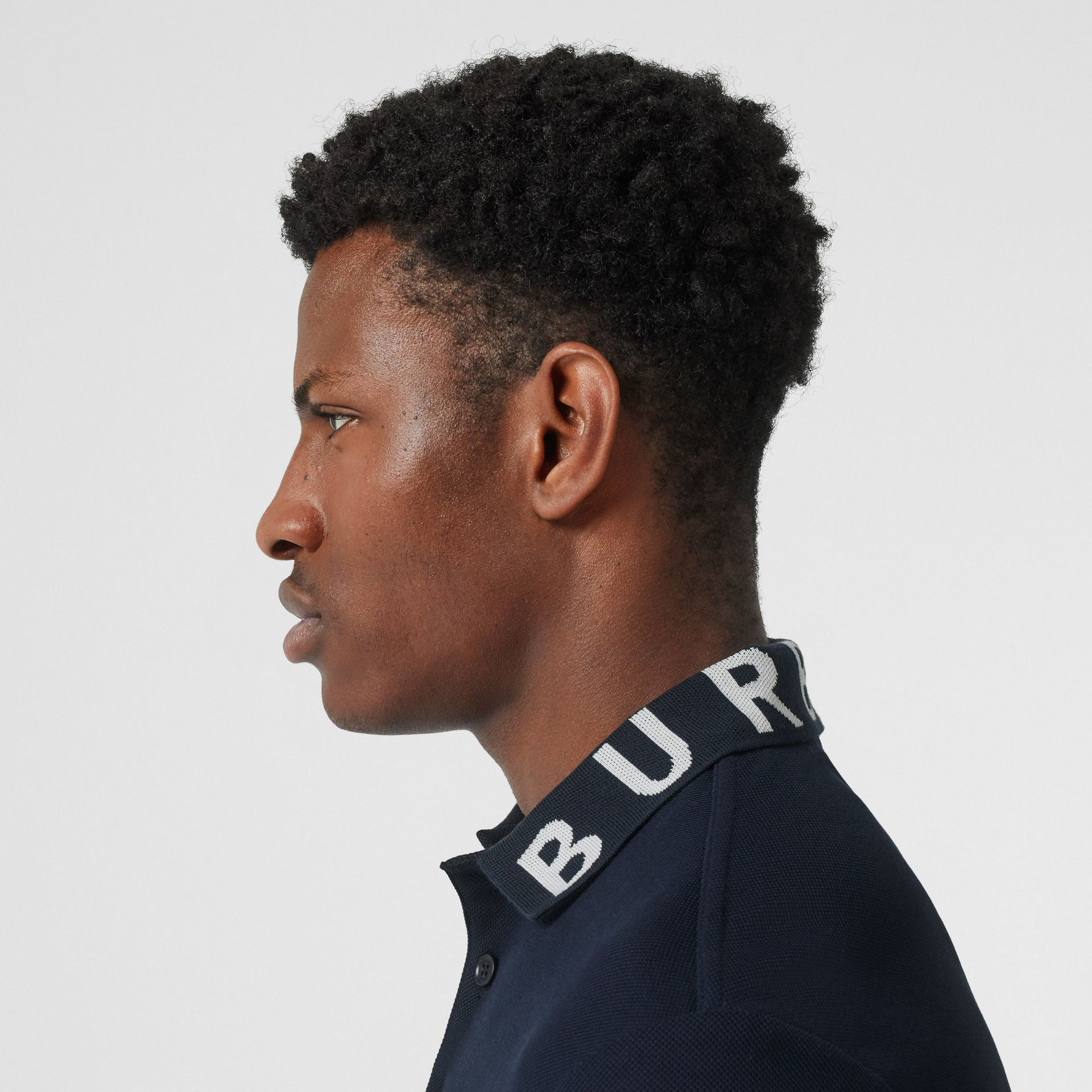 Logo Intarsia Cotton Piqué Polo Shirt in Navy - Men | Burberry - gallery image 1