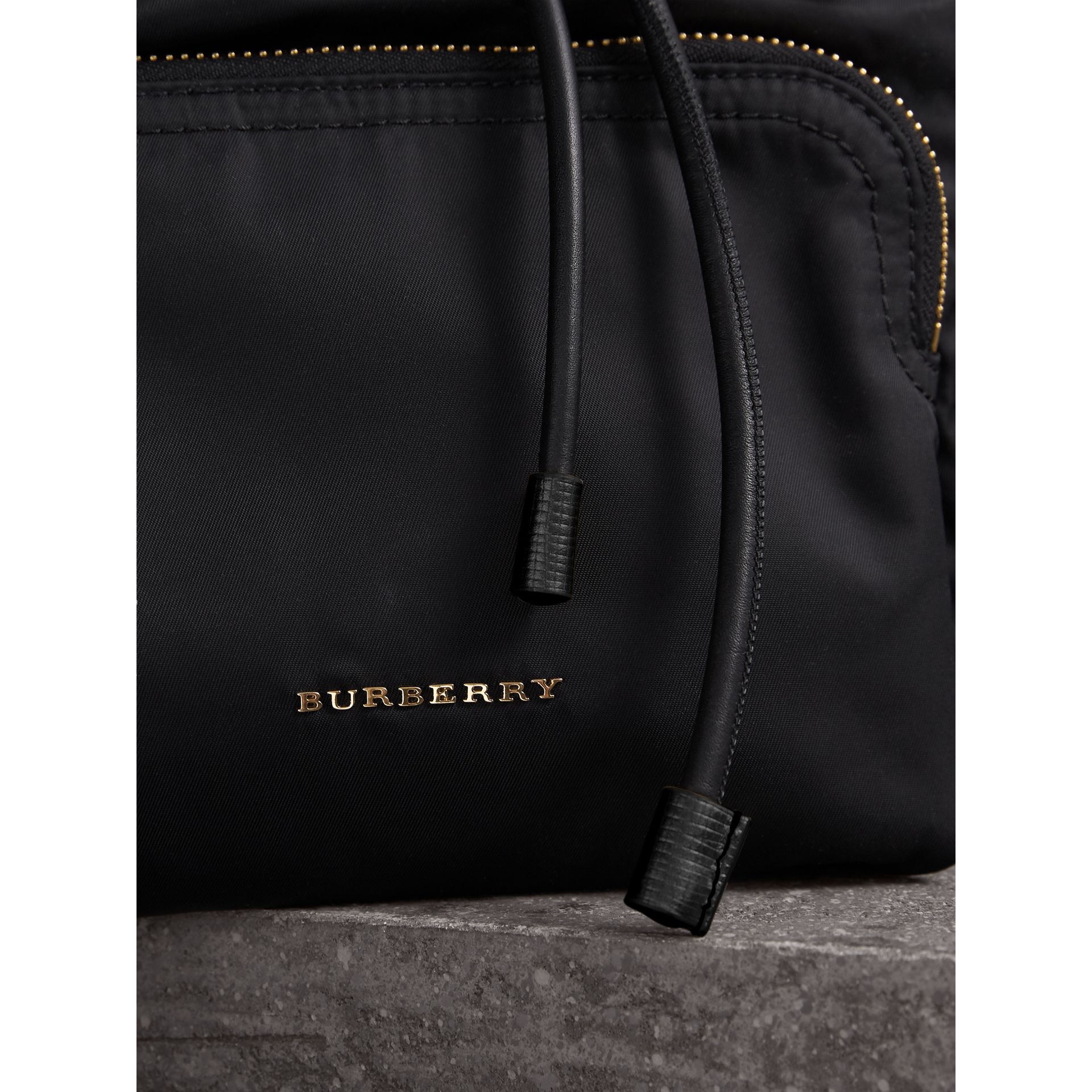 The Medium Rucksack in Two-tone Nylon and Leather in Black/gold - Women | Burberry Hong Kong - gallery image 1