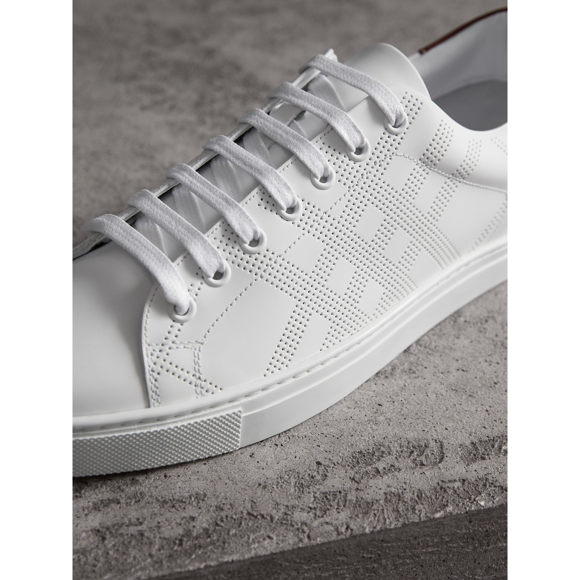 Perforated Check Leather Trainers in Optic White - Men | Burberry - gallery image 2