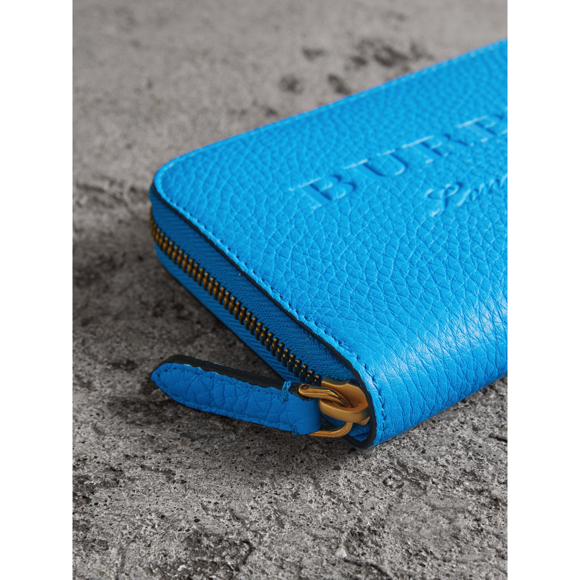 Embossed Leather Ziparound Wallet in Bright Blue - Women | Burberry United Kingdom - gallery image 1