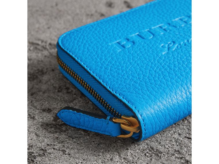 Embossed Leather Ziparound Wallet in Bright Blue - Women | Burberry United Kingdom - cell image 1