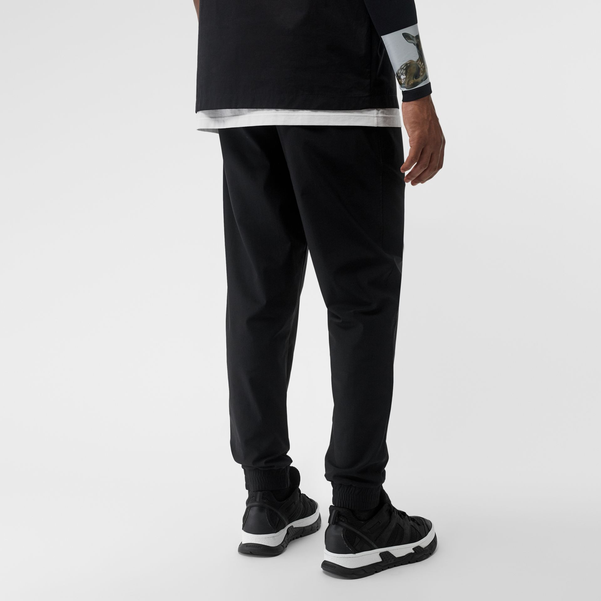 Logo Print Stretch Nylon Trackpants in Black - Men | Burberry Australia - gallery image 2