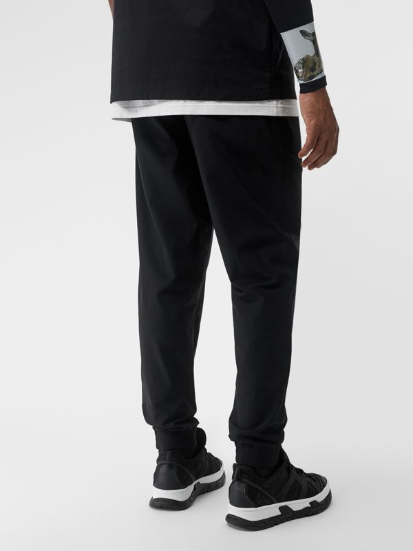 Logo Print Stretch Nylon Trackpants in Black - Men | Burberry United Kingdom - cell image 2