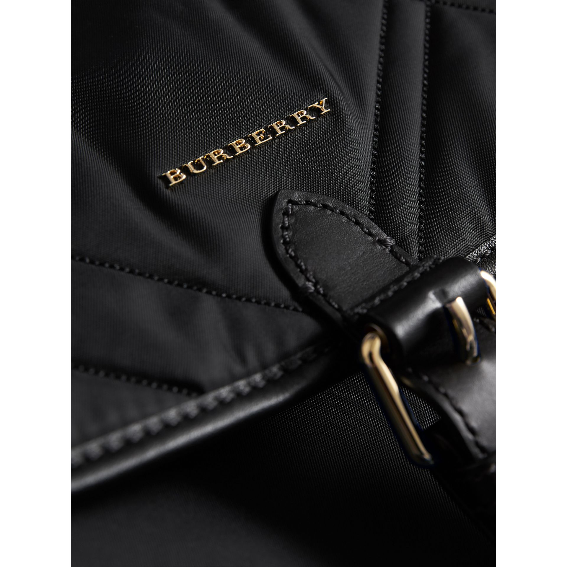 Check-quilted Baby Changing Shoulder Bag in Black | Burberry Singapore - gallery image 1